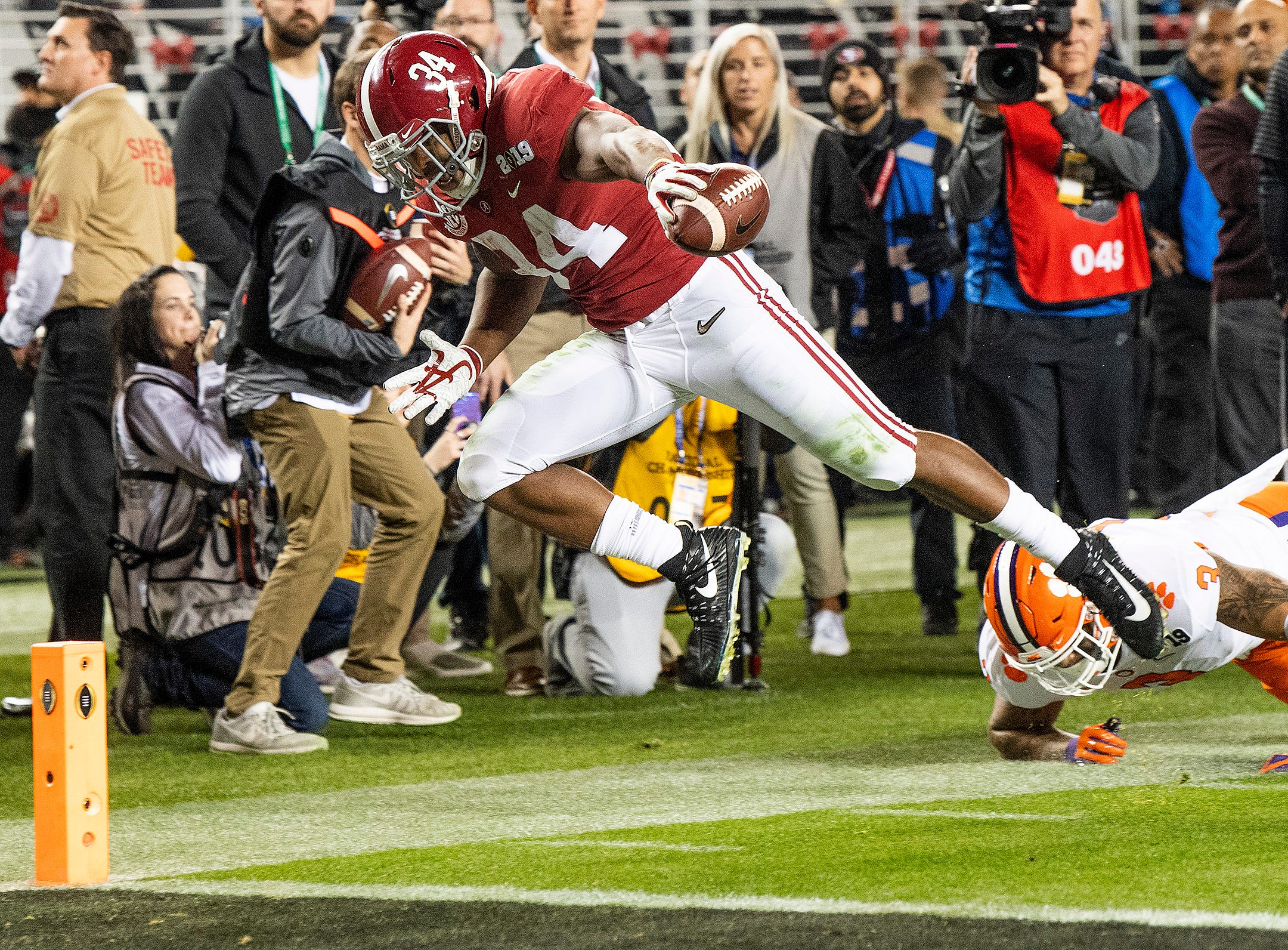 Alabama running back Damien Harris (34) is forced out of bounds by Clemson defensive end Xavier Thomas (3) in second half action of the College Football Playoff National Championship game at Levi's Stadium in Santa Clara, Ca., on Monday January 7, 2019.