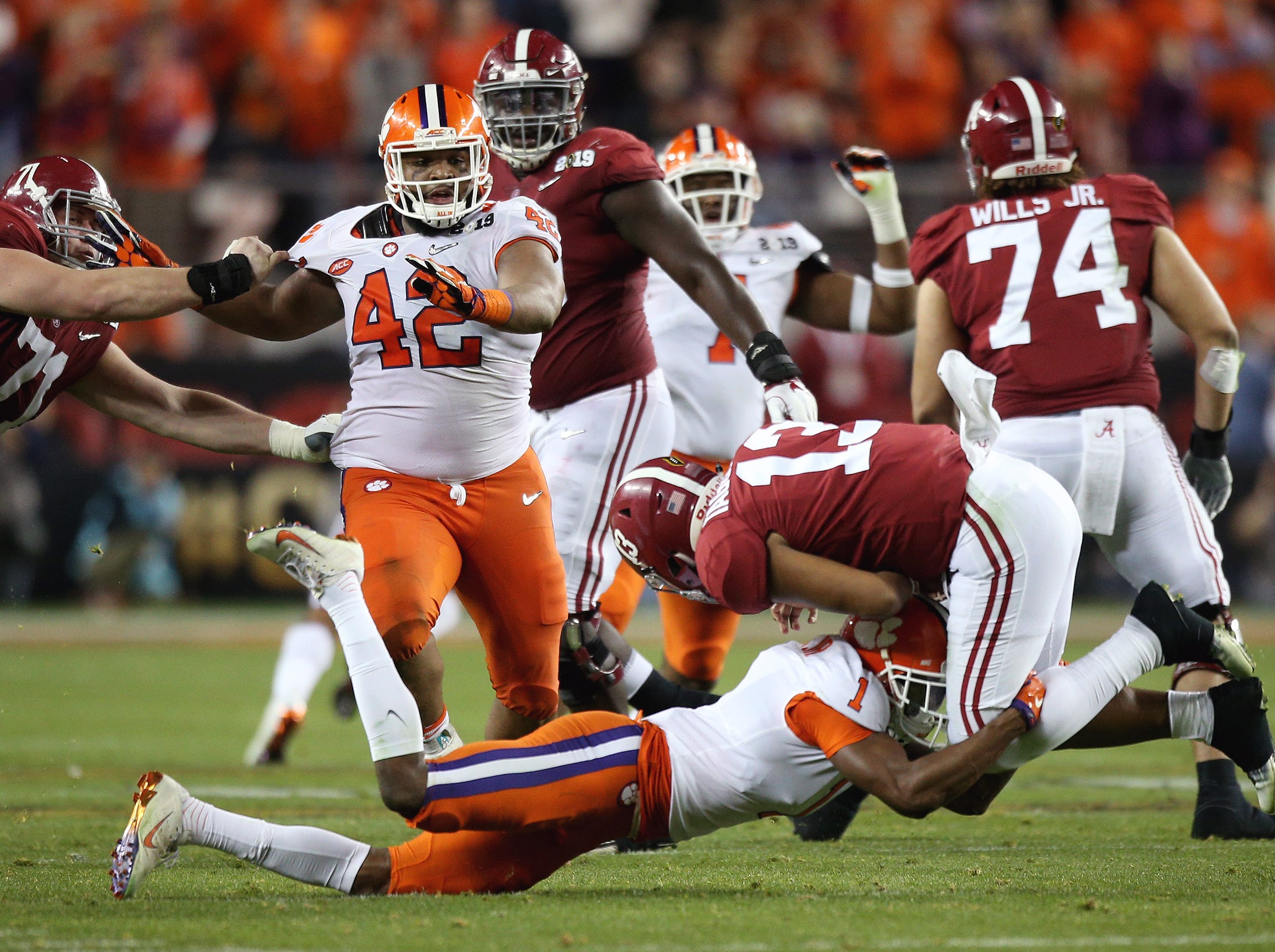 Jan 7, 2019; Santa Clara, CA, USA; Clemson Tigers cornerback Trayvon Mullen (1) tackles Alabama Crimson Tide quarterback Tua Tagovailoa (13) in the second quarter during the 2019 College Football Playoff Championship game at Levi's Stadium. Mandatory Credit: Cary Edmondson-USA TODAY Sports