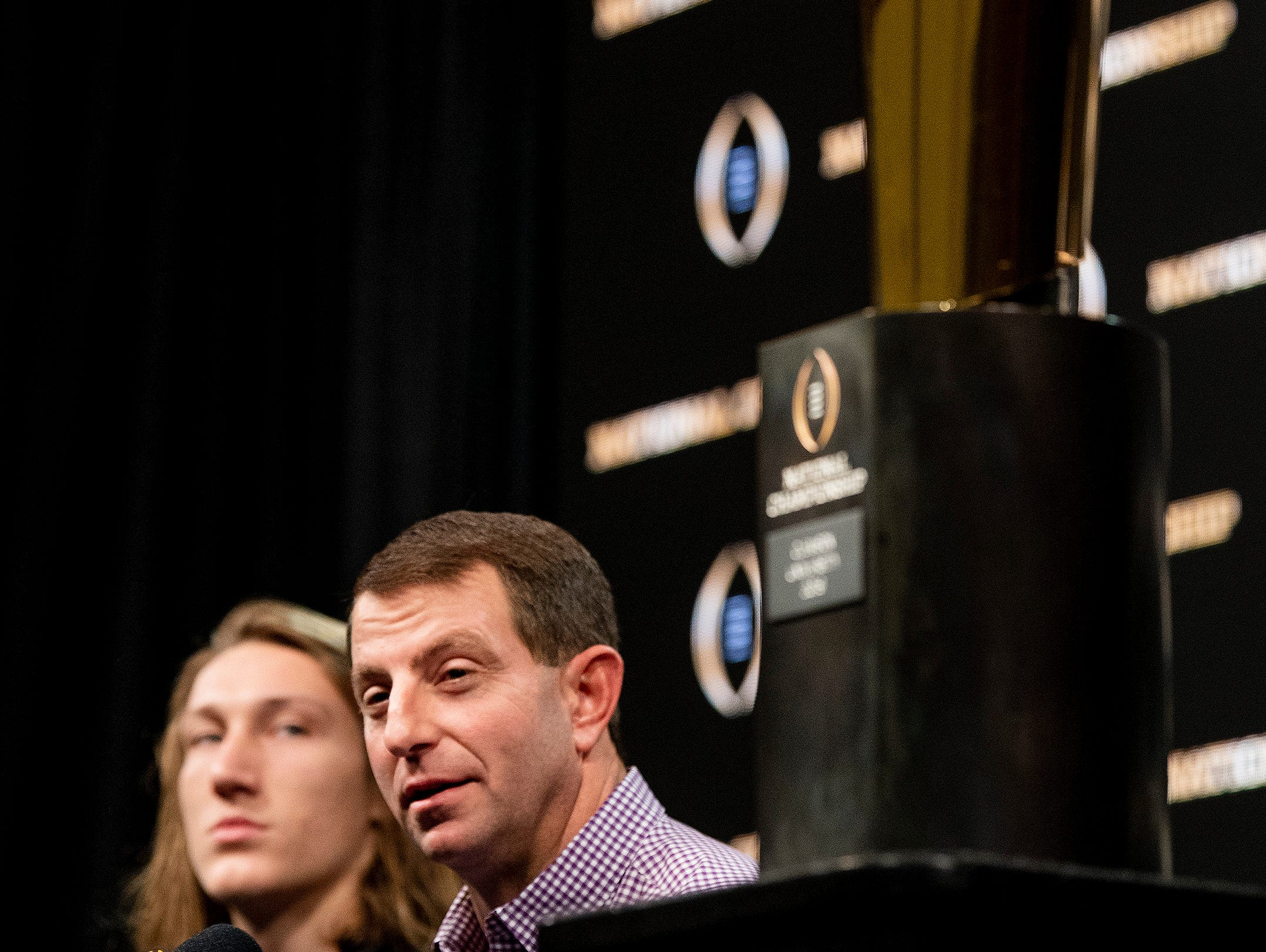 Clemson quarterback Trevor Lawrence (16)  and head coach Dabo Swinney speak during the College Football Playoff National Championship press conference in San Jose, Ca., on Tuesday January 8, 2019.