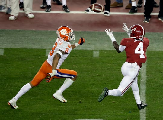 Alabama's Jerry Jeudy catches a pass in front of Clemson's A.J. Terrell during the second half of the NCAA college football playoff championship game, Monday, Jan. 7, 2019, in Santa Clara, Calif. (AP Photo/Jeff Chiu)