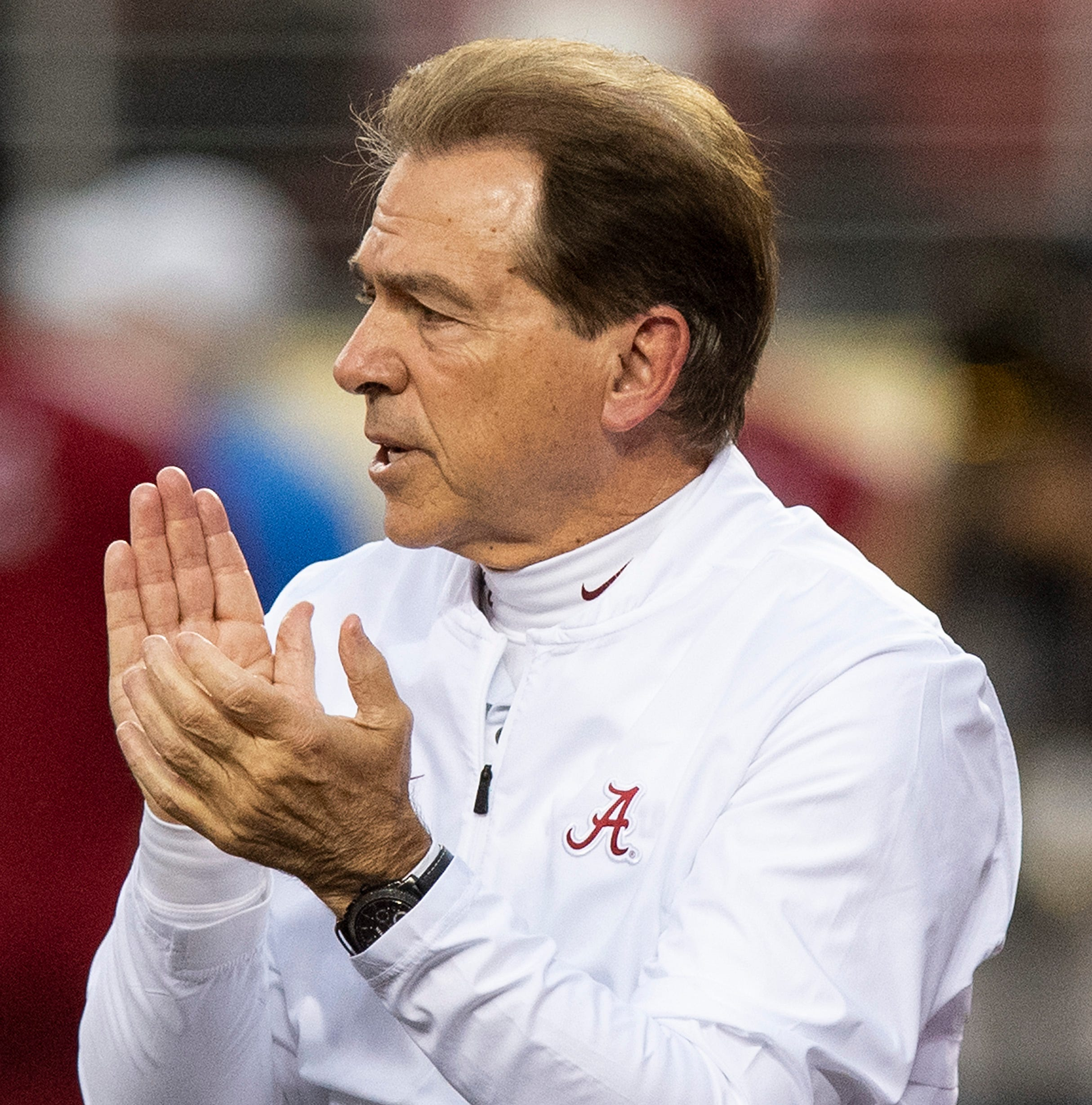 What Nick Saban, other college football coaches really talk about when they visit high schools