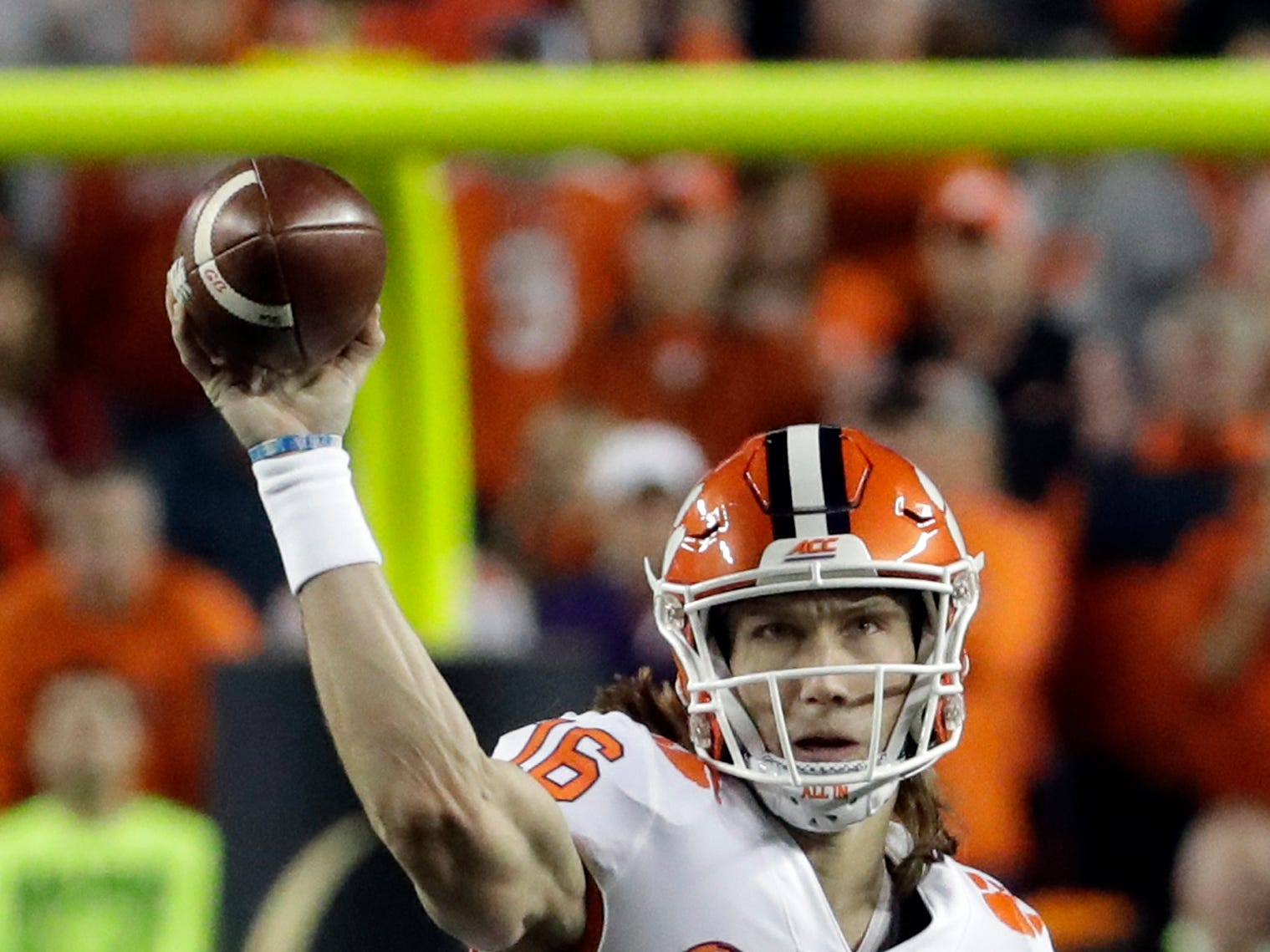 Clemson's Trevor Lawrence throws during the first half of the NCAA college football playoff championship game against Alabama, Monday, Jan. 7, 2019, in Santa Clara, Calif. (AP Photo/Chris Carlson)