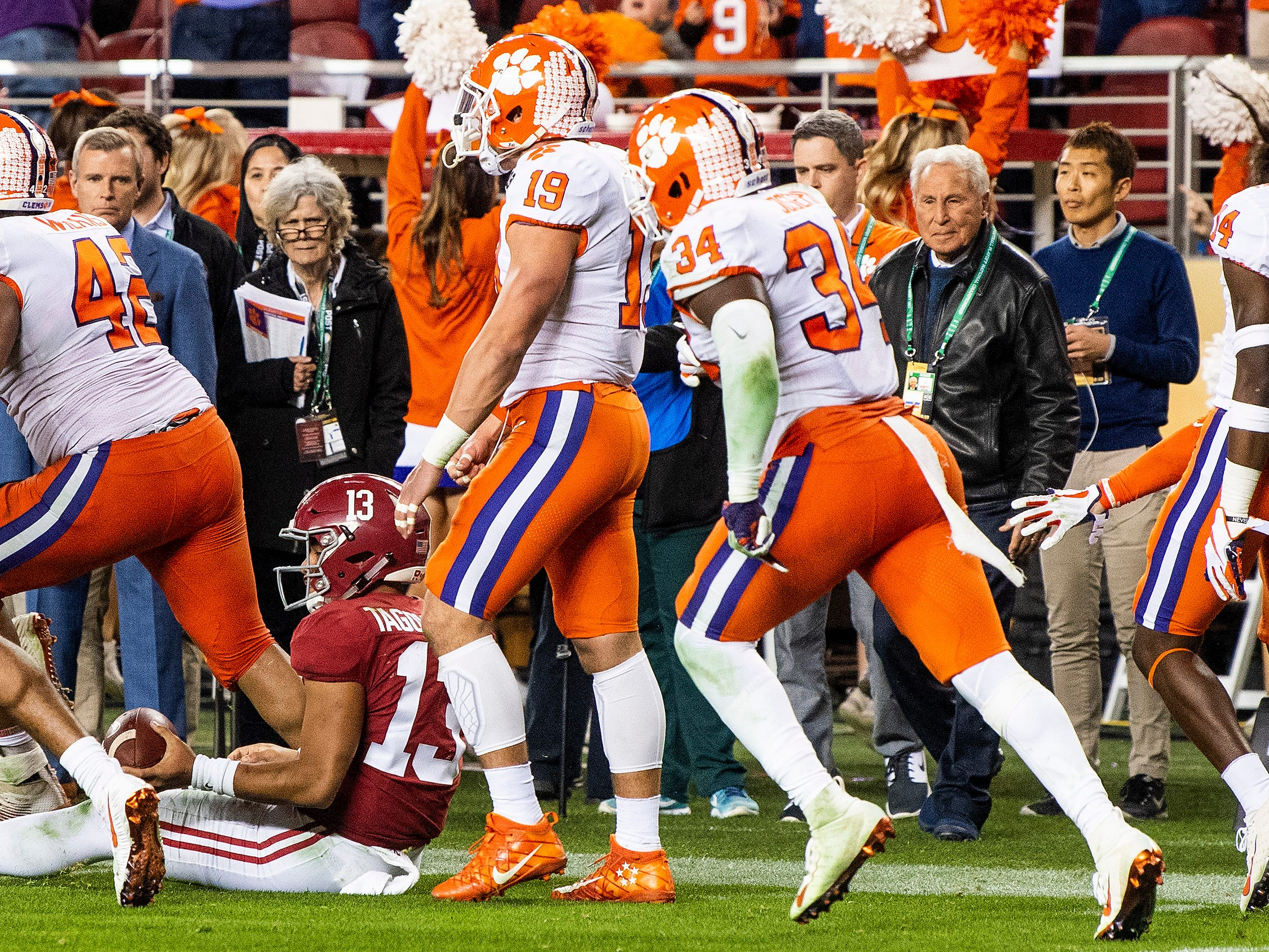 The Clemson defense runs off the field after stopping Alabama quarterback Tua Tagovailoa (13) on a fourth down play In second half action of the College Football Playoff National Championship game at Levi's Stadium in Santa Clara, Ca., on Monday January 7, 2019.