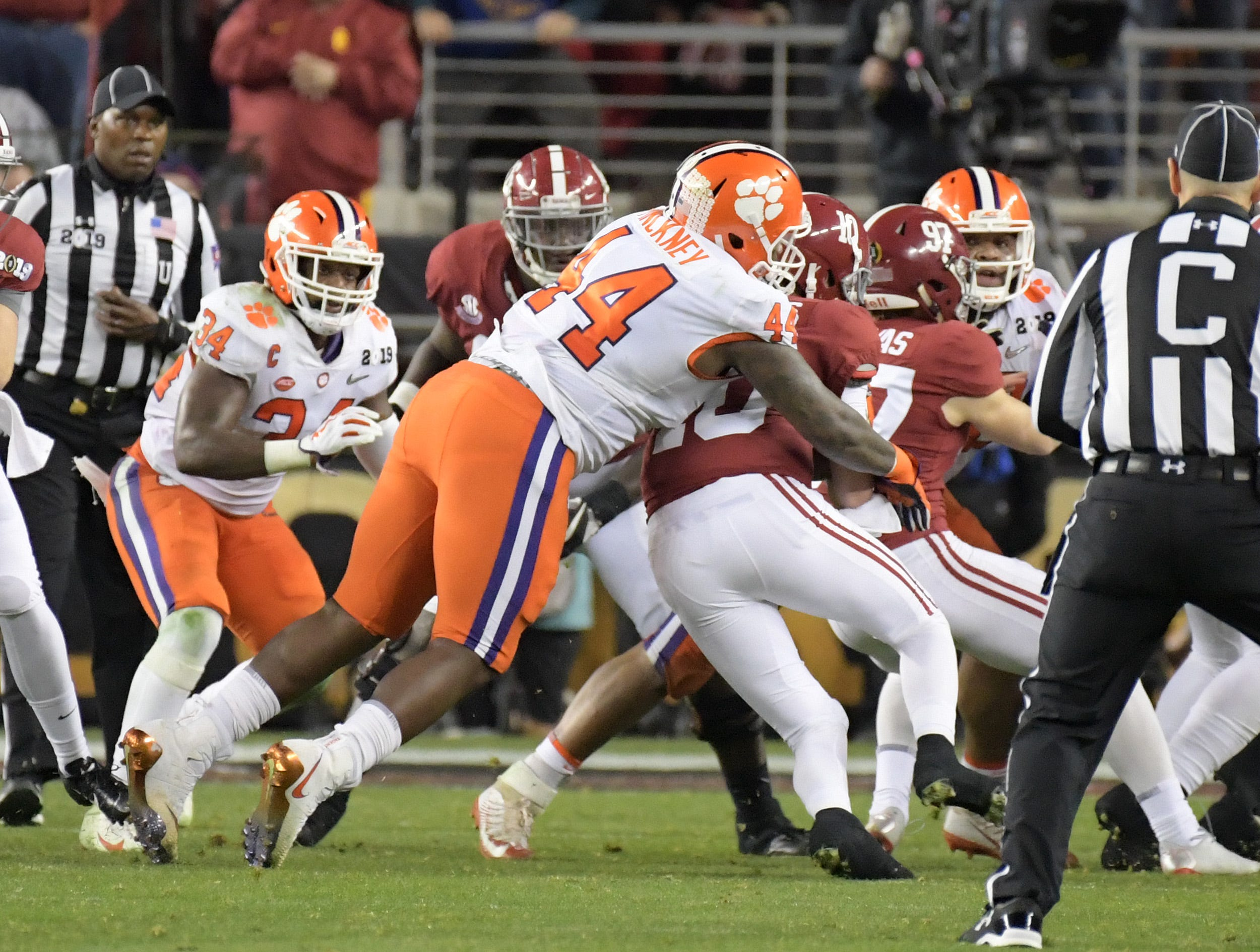 Jan 7, 2019; Santa Clara, CA, USA; Clemson Tigers defensive tackle Nyles Pinckney (44) tackles Alabama Crimson Tide quarterback Mac Jones (10) in the third quarter in the during the 2019 College Football Playoff Championship game at Levi's Stadium. Mandatory Credit: Kirby Lee-USA TODAY Sports