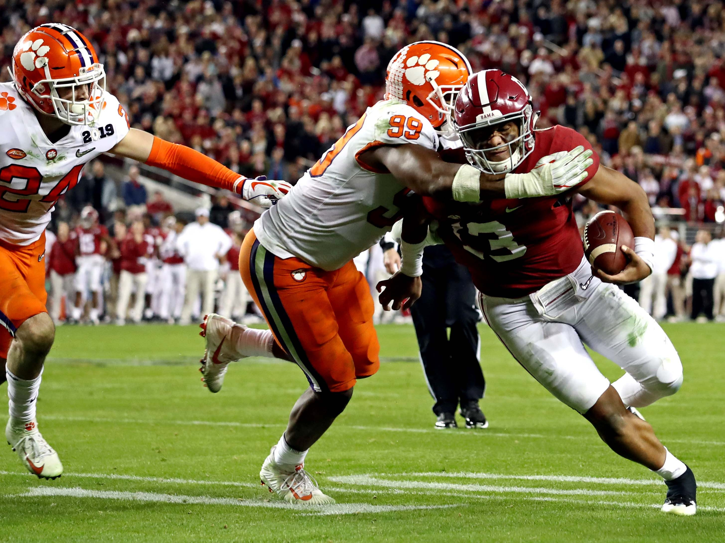 Jan 7, 2019; Santa Clara, CA, USA; Alabama Crimson Tide quarterback Tua Tagovailoa (13) runs the ball against Clemson Tigers defensive end Clelin Ferrell (99) during the fourth quarter during the 2019 College Football Playoff Championship game at Levi's Stadium. Mandatory Credit: Matthew Emmons-USA TODAY Sports