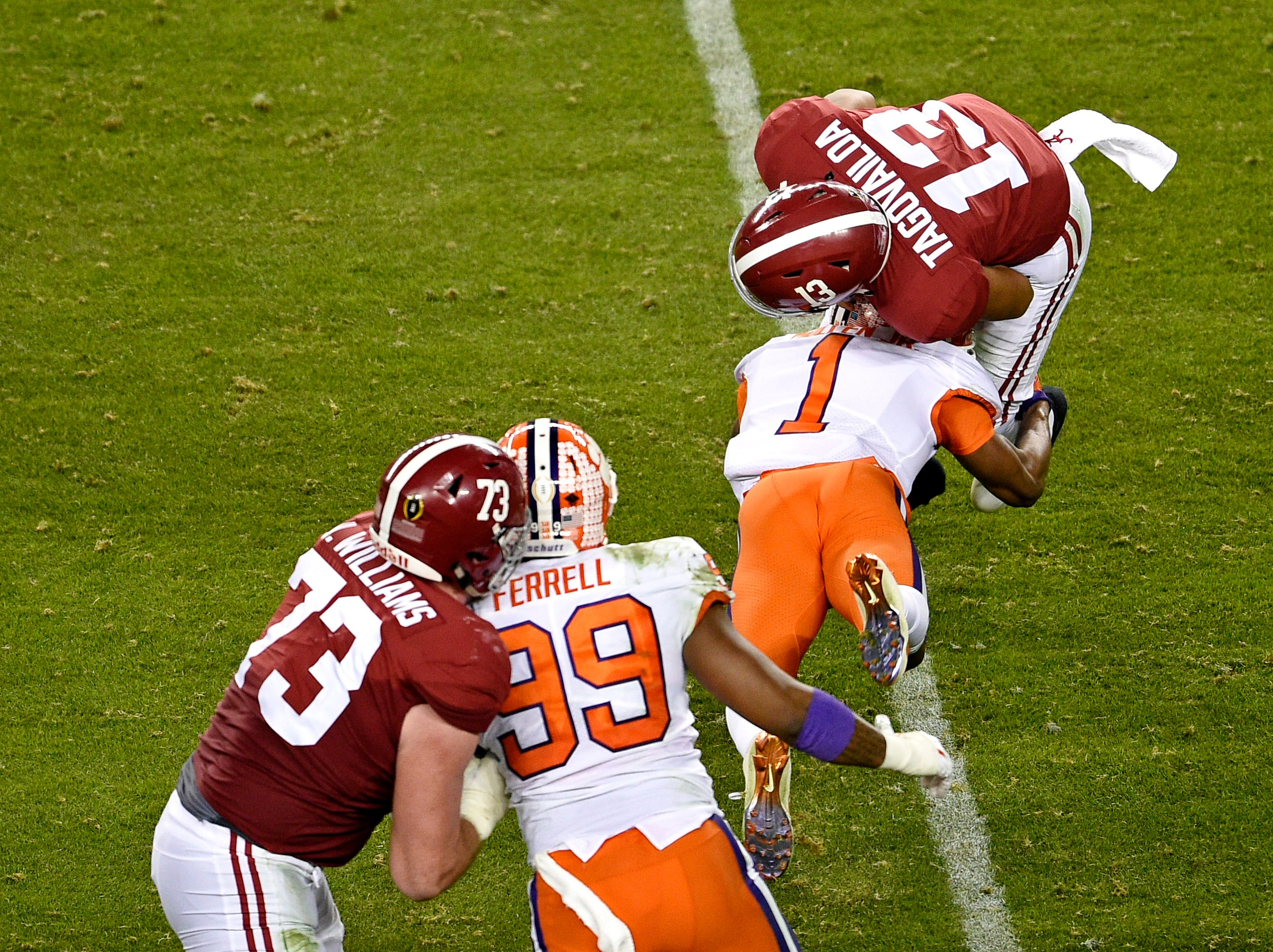 Jan 7, 2019; Santa Clara, CA, USA; Clemson Tigers cornerback Trayvon Mullen (1) sacks Alabama Crimson Tide quarterback Tua Tagovailoa (13) during the first half during the 2019 College Football Playoff Championship game at Levi's Stadium. Mandatory Credit: Kelvin Kuo-USA TODAY Sports