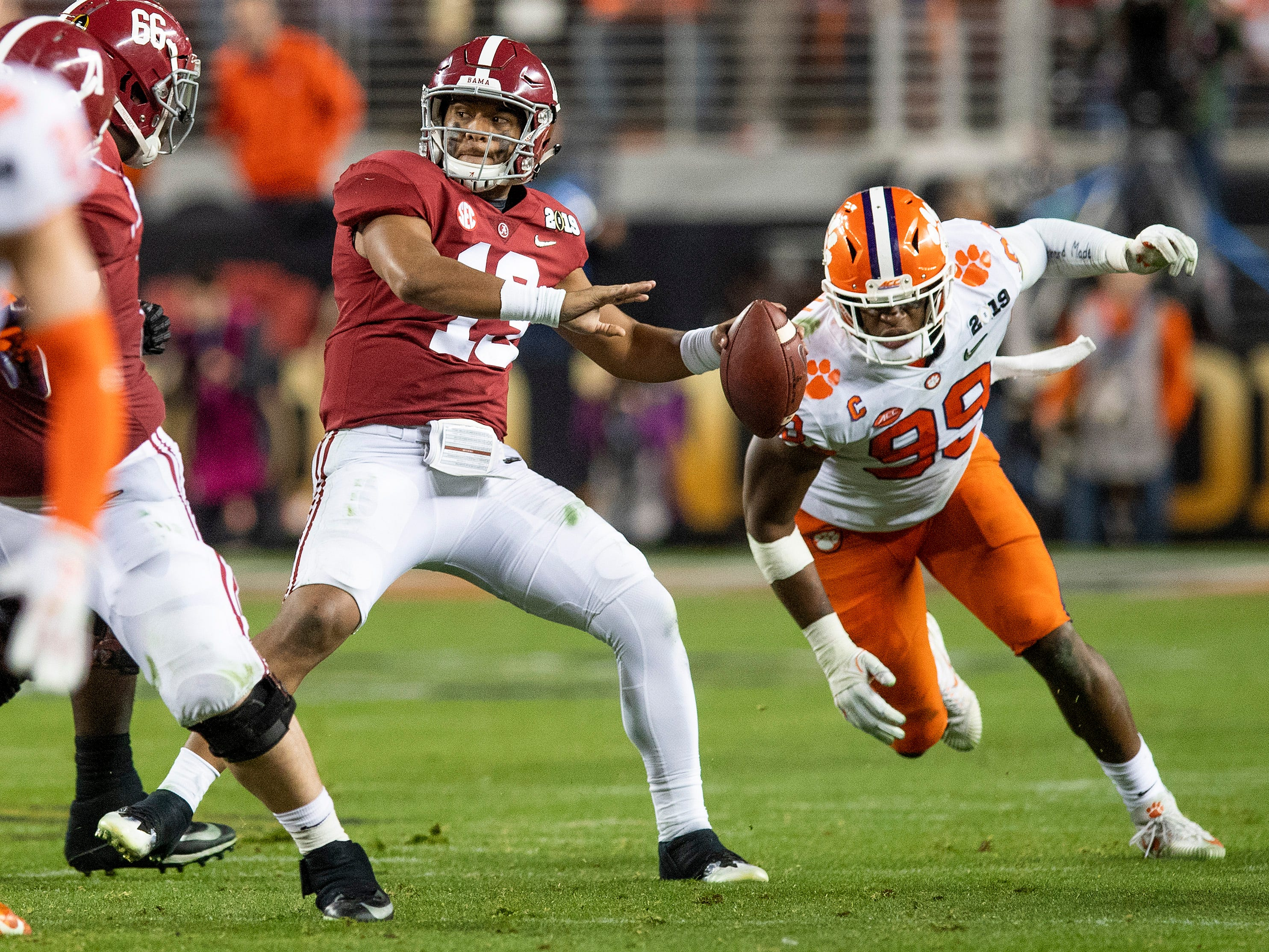 Alabama quarterback Tua Tagovailoa (13) passes against Clemson In second half action of the College Football Playoff National Championship game at Levi's Stadium in Santa Clara, Ca., on Monday January 7, 2019.