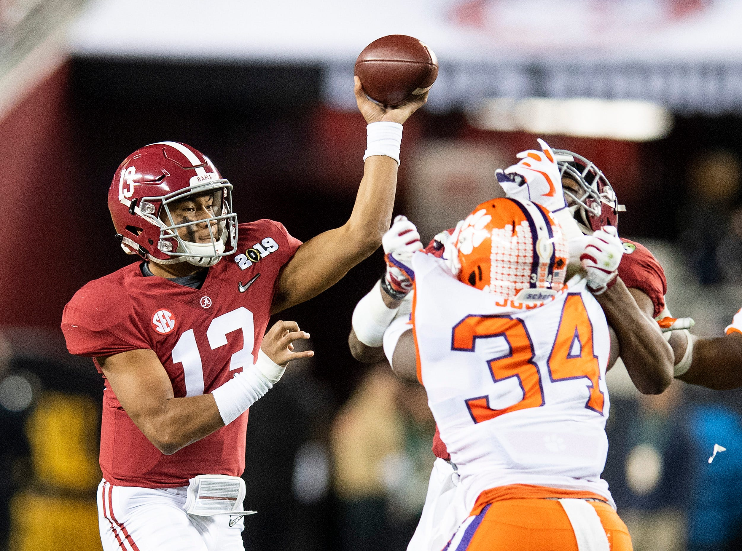 Alabama quarterback Tua Tagovailoa (13) passes against Clemson In first half action of the College Football Playoff National Championship game at Levi's Stadium in Santa Clara, Ca., on Monday January 7, 2019.