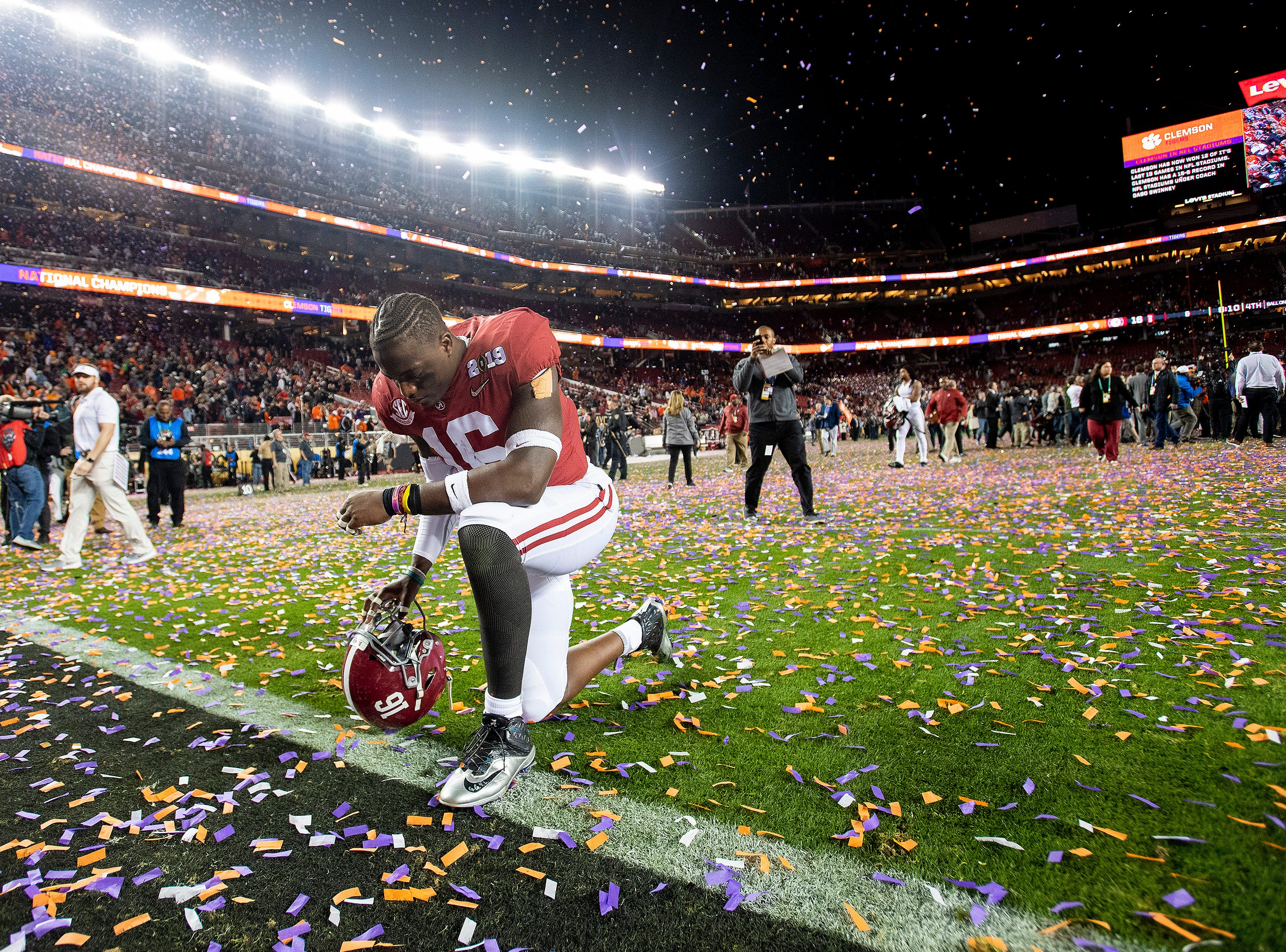 Alabama linebacker Jamey Mosley (16) kneels and prays after losing to Clemson in the College Football Playoff National Championship game at Levi's Stadium in Santa Clara, Ca., on Monday January 7, 2019.