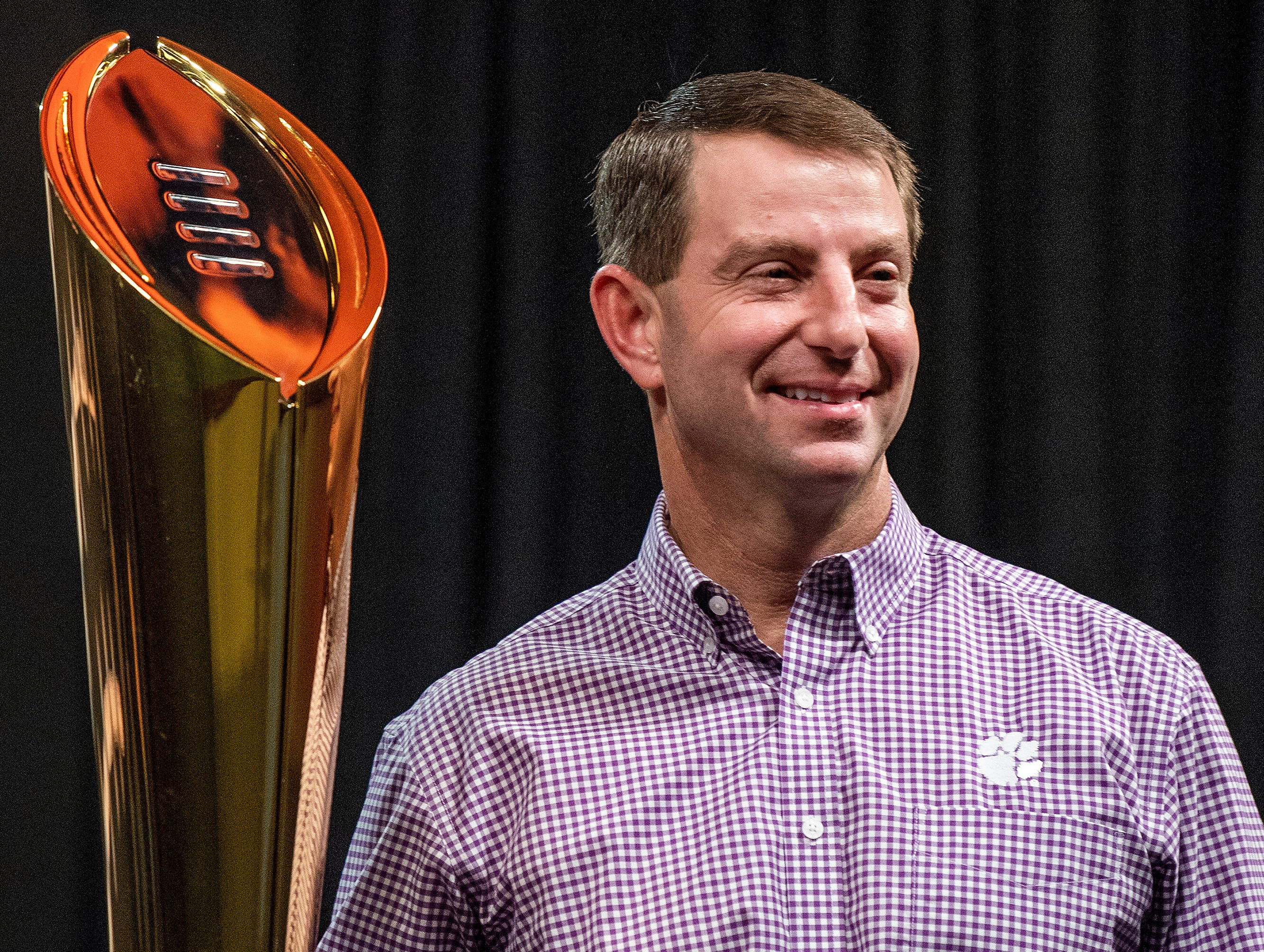 Clemson head coach Dabo Swinney poses with the National Championship Trophy during the College Football Playoff National Championship press conference in San Jose, Ca., on Tuesday January 8, 2019.