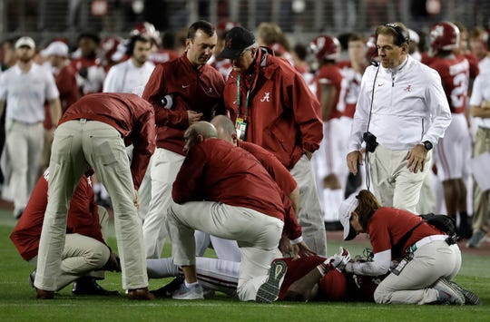 Alabama head coach Nick Saban looks on as Saivion Smith is injured during the second half of the NCAA college football playoff championship game against Clemson, Monday, Jan. 7, 2019, in Santa Clara, Calif. (AP Photo/Chris Carlson)