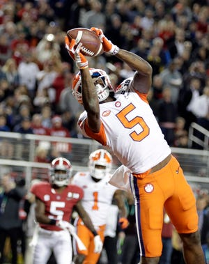 Clemson's Tee Higgins catches a touchdown pass during the second half of the NCAA college football playoff championship game against Alabama, Monday, Jan. 7, 2019, in Santa Clara, Calif. (AP Photo/David J. Phillip)