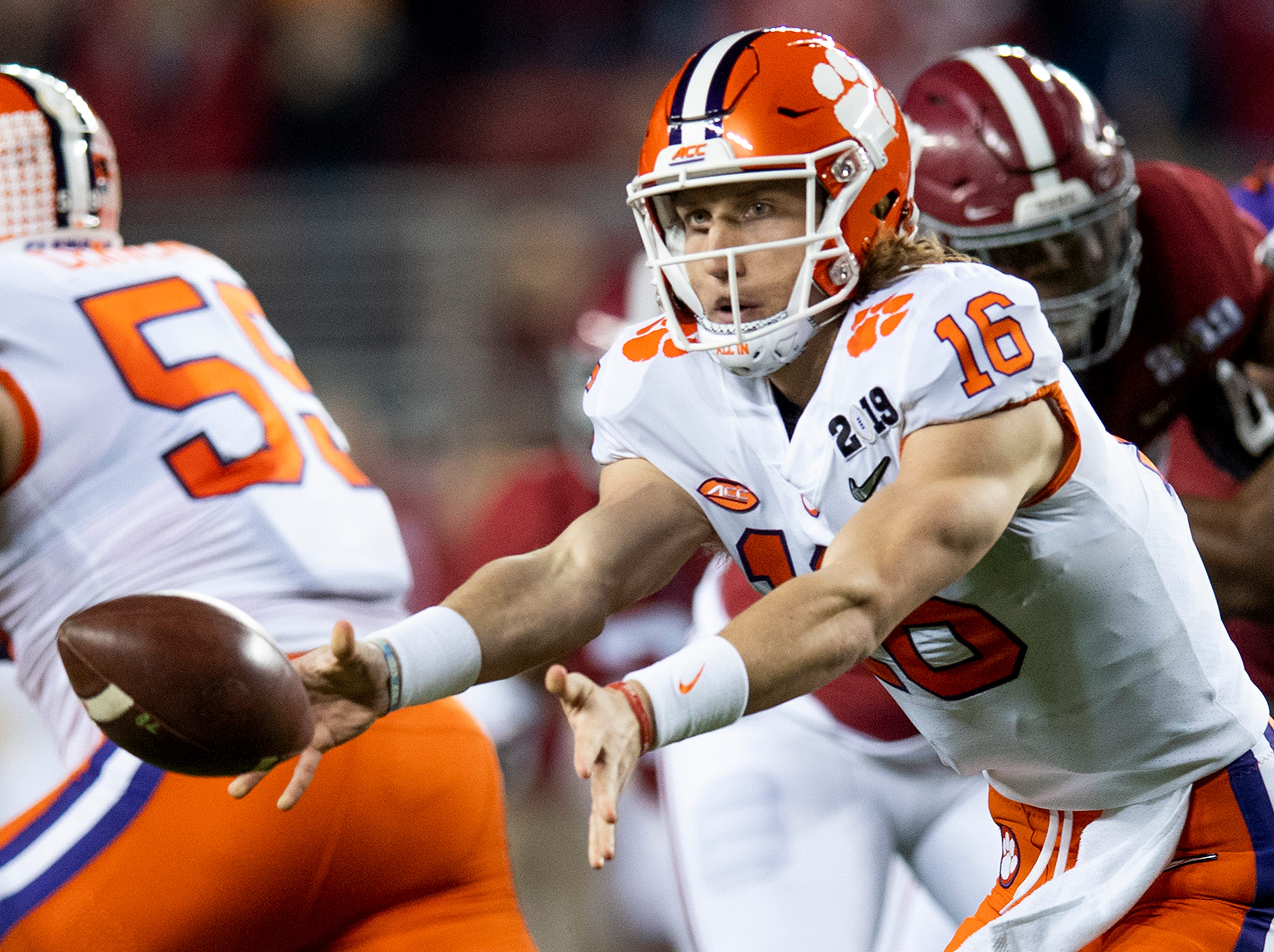 Clemson quarterback Trevor Lawrence (16)  pitches out the ball to running back Travis Etienne (9) in first half action of the College Football Playoff National Championship game at Levi's Stadium in Santa Clara, Ca., on Monday January 7, 2019.
