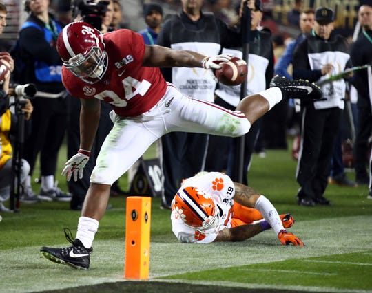 Alabama's Damien Harris is stopped short of the goal line during the second half of the NCAA college football playoff championship game against Clemson, Monday, Jan. 7, 2019, in Santa Clara, Calif. (AP Photo/Ben Margot)