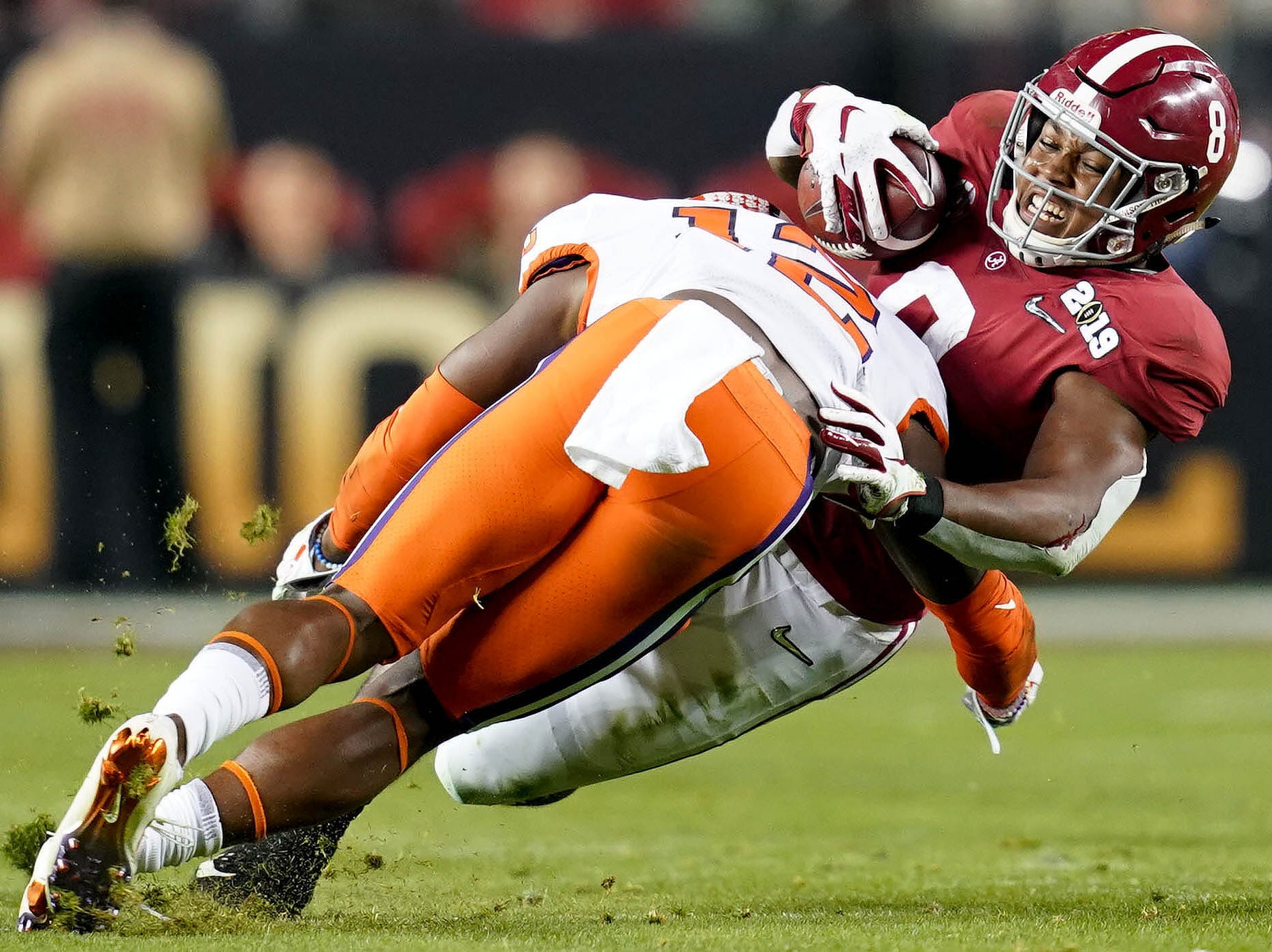 Jan 7, 2019; Santa Clara, CA, USA; Alabama Crimson Tide running back Josh Jacobs (8) is tackled by Clemson Tigers defensive back K'Von Wallace (12) during the second quarter in the 2019 College Football Playoff Championship game at Levi's Stadium. Mandatory Credit: Kyle Terada-USA TODAY Sports