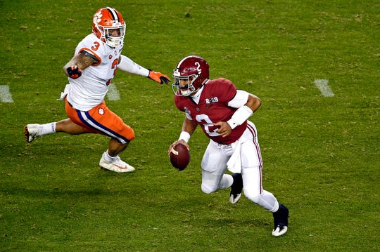 Jan 7, 2019; Santa Clara, CA, USA; Alabama Crimson Tide quarterback Jalen Hurts (2) runs the ball against Clemson Tigers defensive lineman Xavier Thomas (3) during the fourth quarter during the 2019 College Football Playoff Championship game at Levi's Stadium. Mandatory Credit: Kelvin Kuo-USA TODAY Sports