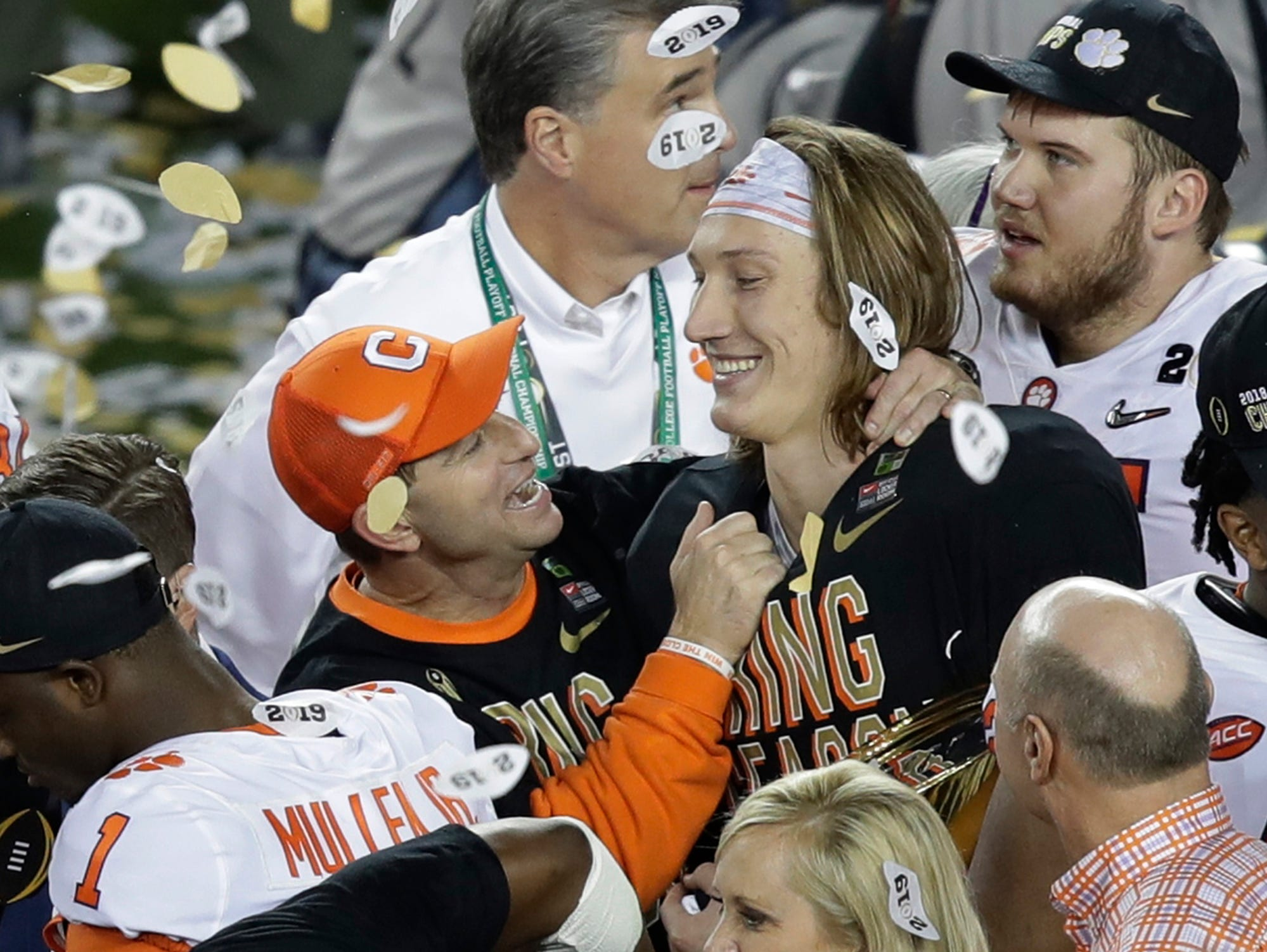 Clemson head coach Dabo Swinney celebrates with Trevor Lawrence after the NCAA college football playoff championship game against Alabama, Monday, Jan. 7, 2019, in Santa Clara, Calif. Clemson beat Alabama 44-16. (AP Photo/Jeff Chiu)