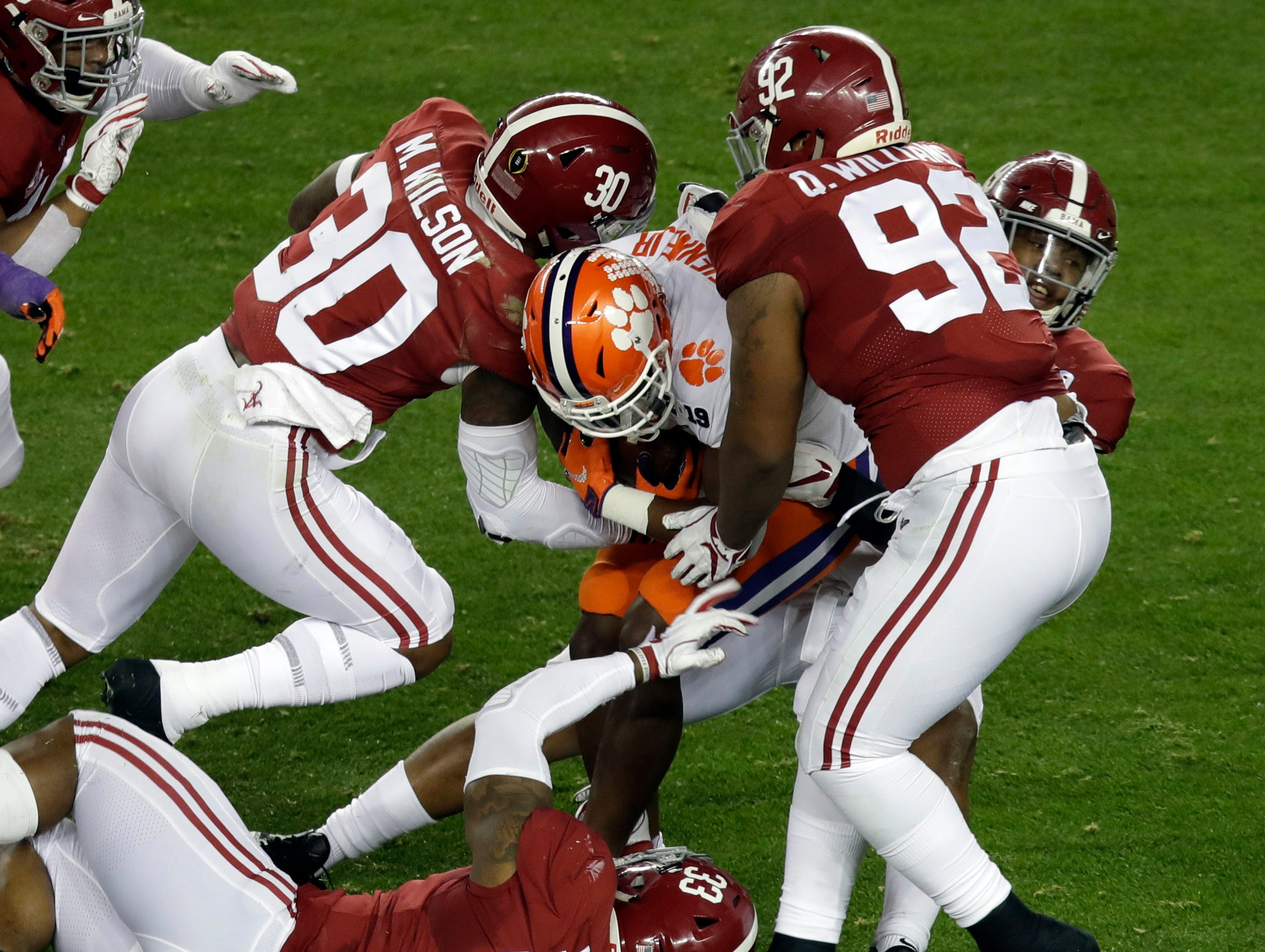 Clemson's Travis Etienne is stopped during the first half the NCAA college football playoff championship game against Alabama, Monday, Jan. 7, 2019, in Santa Clara, Calif. (AP Photo/Jeff Chiu)