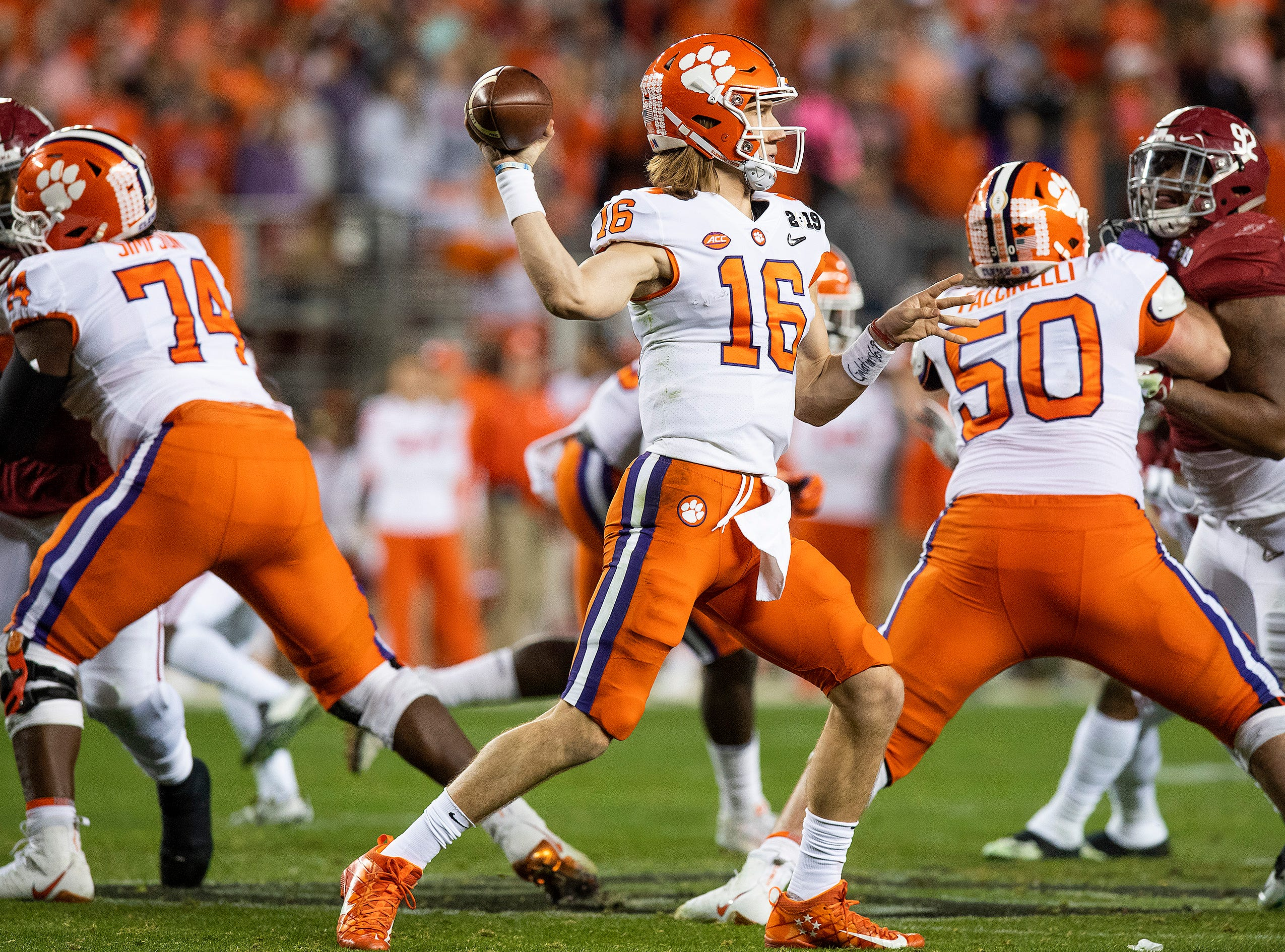 Clemson quarterback Trevor Lawrence (16) passes against Alabama In second half action of the College Football Playoff National Championship game at Levi's Stadium in Santa Clara, Ca., on Monday January 7, 2019.