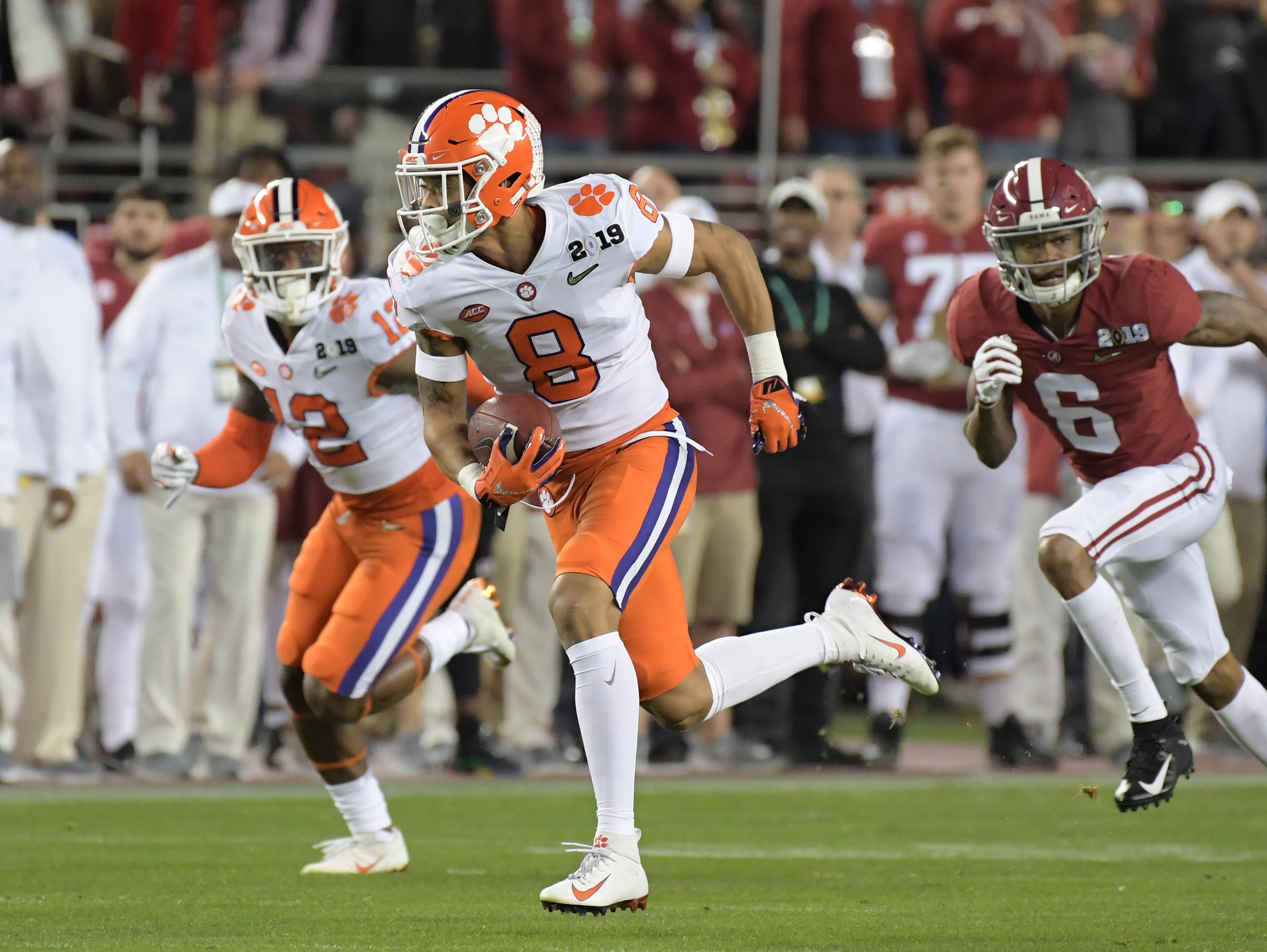 Jan 7, 2019; Santa Clara, CA, USA; Clemson Tigers cornerback A.J. Terrell (8) runs to score on an interception return against the Alabama Crimson Tide during the 2019 College Football Playoff Championship game at Levi's Stadium. Mandatory Credit: Kirby Lee-USA TODAY Sports