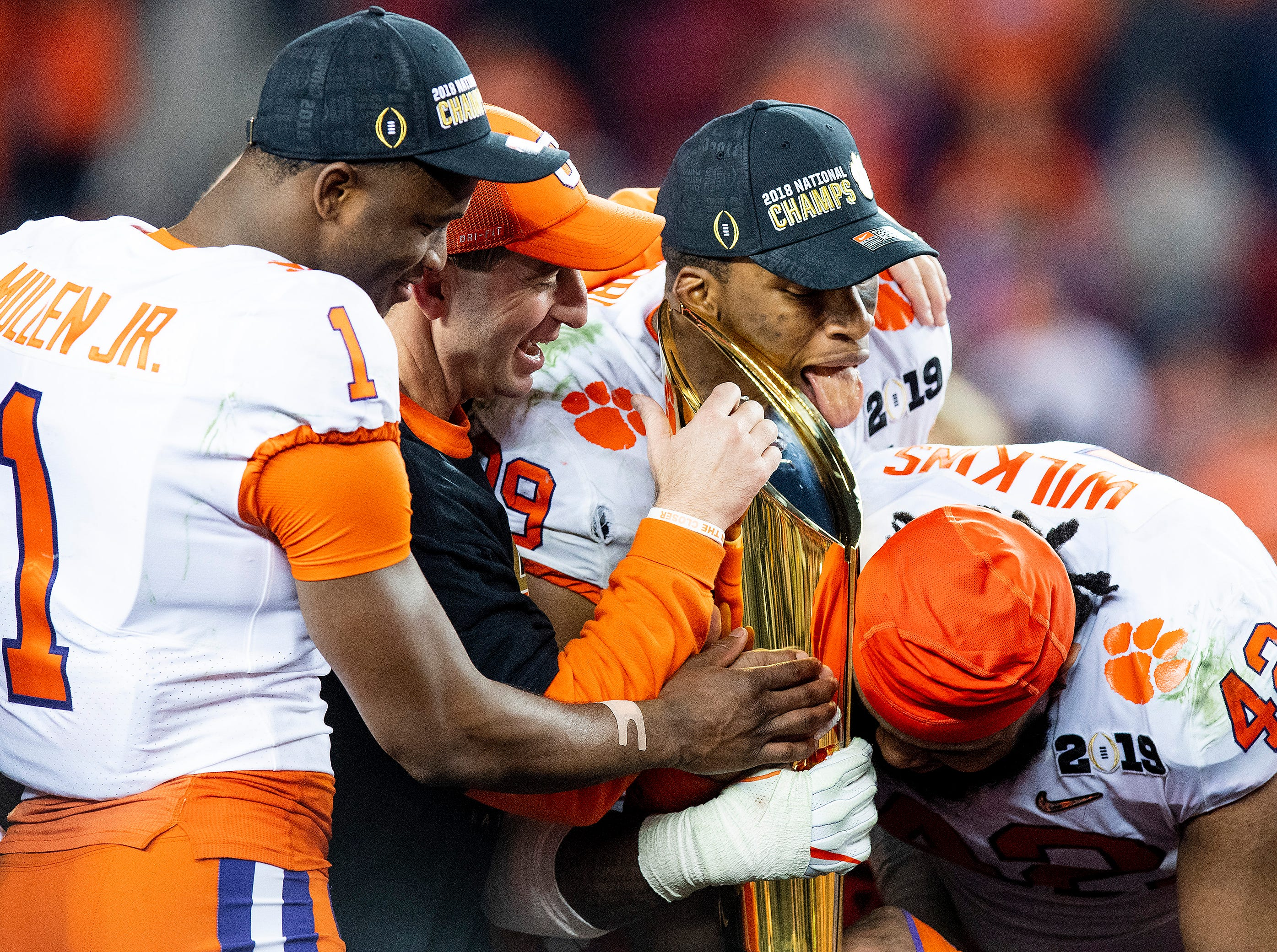 Clemson cornerback Trayvon Mullen (1), head coach Dabo Swinney , defensive end Clelin Ferrell (99) and defensive tackle Christian Wilkins (42) claim their trophy after defeating Alabama in the College Football Playoff National Championship game at Levi's Stadium in Santa Clara, Ca., on Monday January 7, 2019.