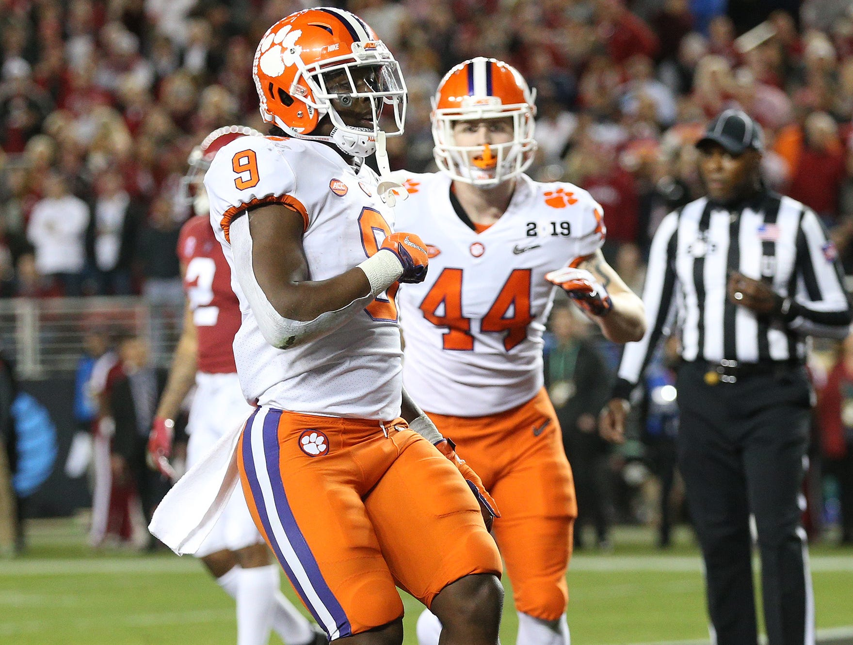 Jan 7, 2019; Santa Clara, CA, USA; Clemson Tigers running back Travis Etienne (9) celebrates after scoring a touchdown in the second quarter against the Alabama Crimson Tide during the 2019 College Football Playoff Championship game at Levi's Stadium. Mandatory Credit: Cary Edmondson-USA TODAY Sports