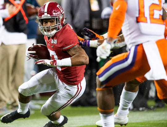 Alabama wide receiver Jaylen Waddle (17) carries the ball against Clemson In second half action of the College Football Playoff National Championship game at Levi's Stadium in Santa Clara, Ca., on Monday January 7, 2019.
