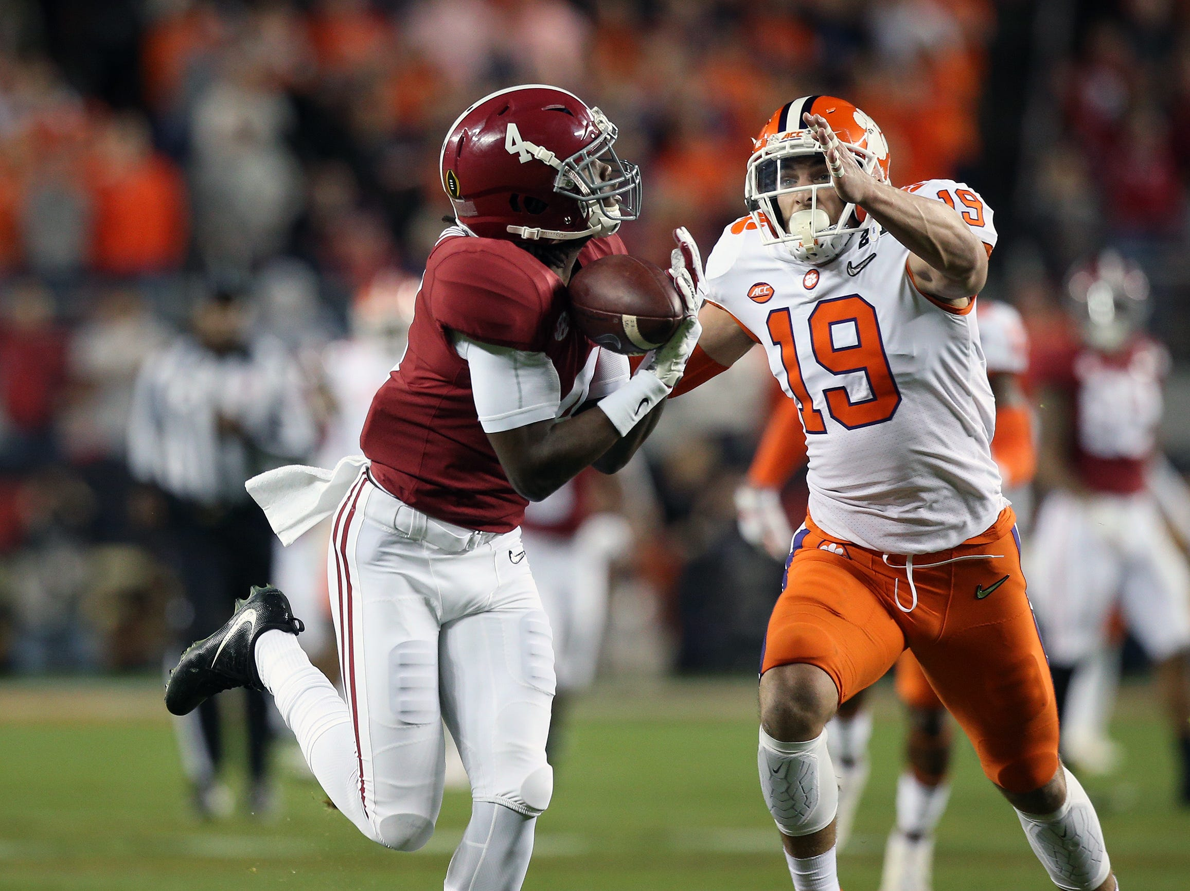 Jan 7, 2019; Santa Clara, CA, USA; Alabama Crimson Tide wide receiver Jerry Jeudy (4) makes a catch against Clemson Tigers safety Tanner Muse (19) in the first quarter during the 2019 College Football Playoff Championship game at Levi's Stadium. Mandatory Credit: Cary Edmondson-USA TODAY Sports