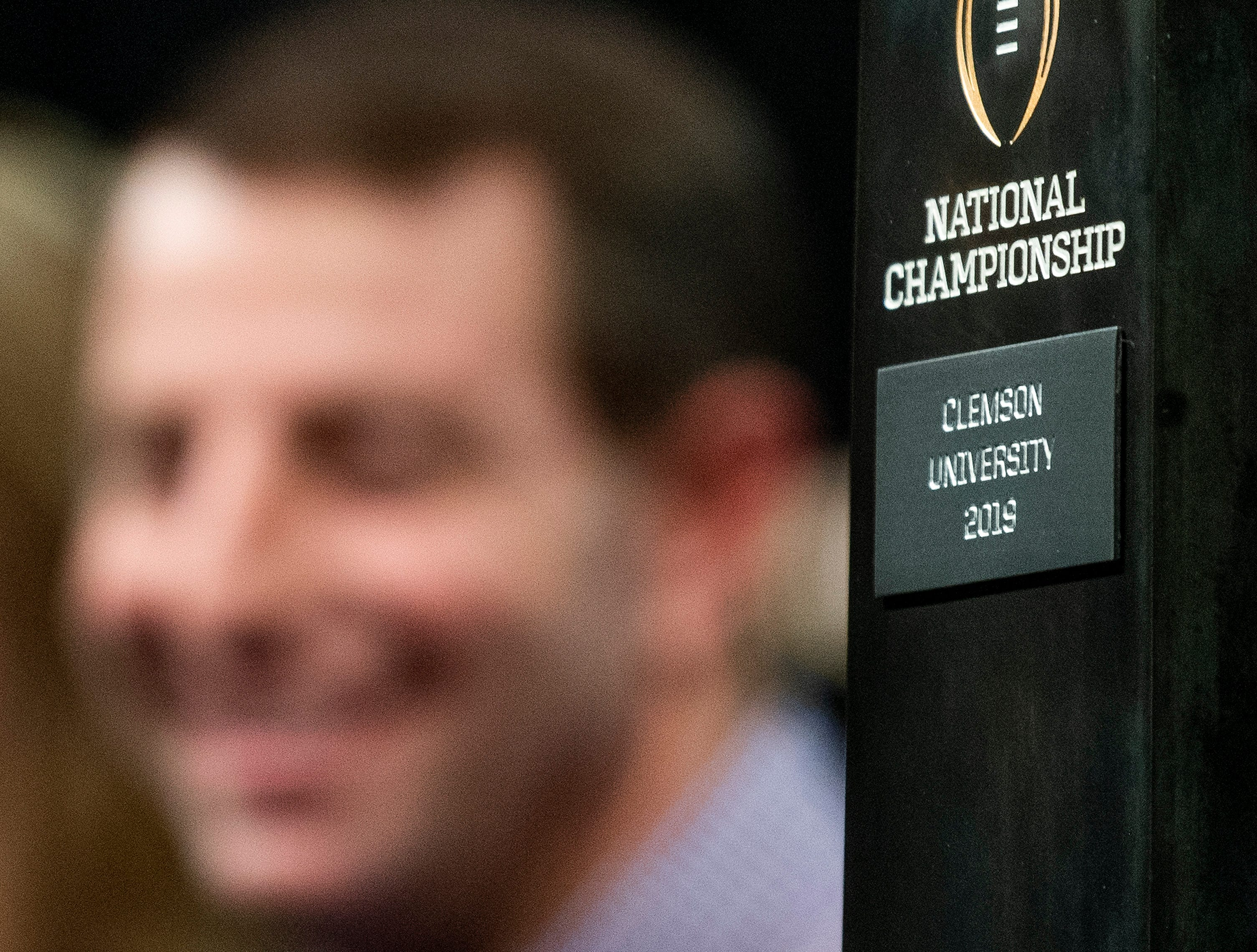 Clemson head coach Dabo Swinney is seen in The background during the College Football Playoff National Championship press conference in San Jose, Ca., on Tuesday January 8, 2019.