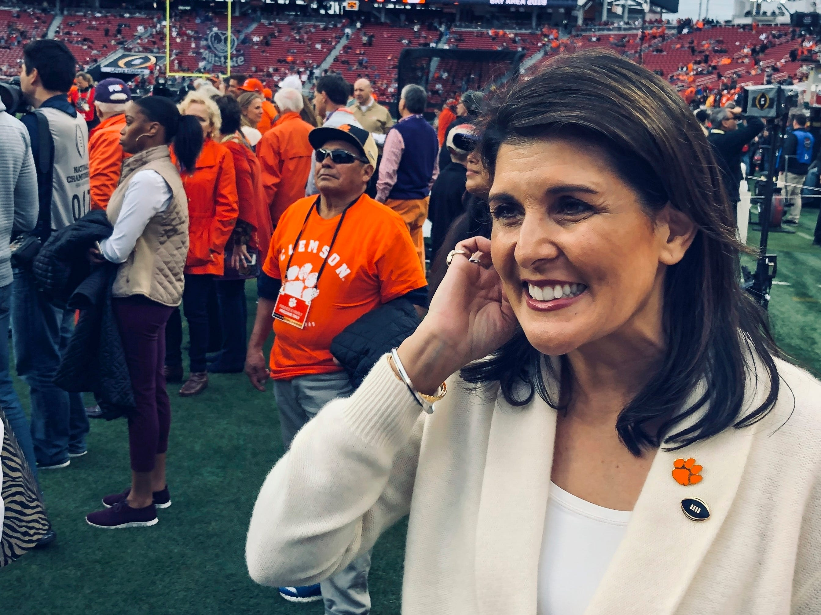 Former United Nations Ambassador Nikki Haley watches warm up on the sideline before the NCAA college football playoff championship game between Alabama and Clemson Monday, Jan. 7, 2019, in Santa Clara, Calif. (AP Photo/Paul Newberry)