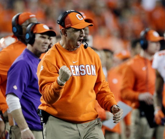 Clemson head coach Dabo Swinney reacts after his defense held on a fourth down play during the second half of the NCAA college football playoff championship game against Alabama, Monday, Jan. 7, 2019, in Santa Clara, Calif. (AP Photo/David J. Phillip)