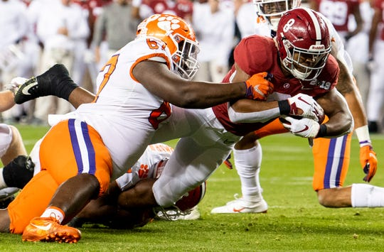 Alabama running back Josh Jacobs (8) dives for a first down on a fourth down play against Clemson in first half action of the College Football Playoff National Championship game at Levi's Stadium in Santa Clara, Ca., on Monday January 7, 2019.