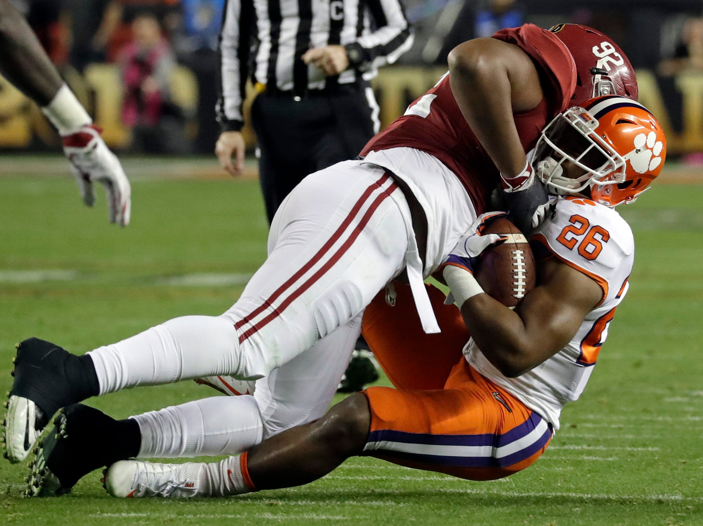 Clemson's Adam Choice is stopped by Alabama's Quinnen Williams during the first half of the NCAA college football playoff championship game Monday, Jan. 7, 2019, in Santa Clara, Calif. (AP Photo/Chris Carlson)