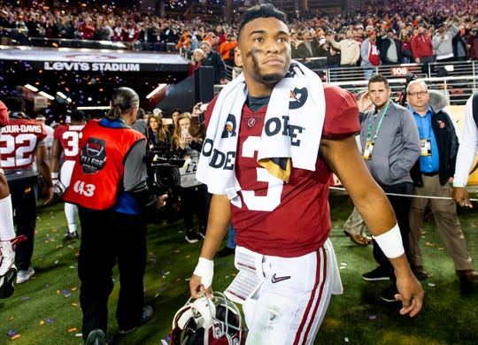 Alabama quarterback Tua Tagovailoa (13) walks off the field after losing to Clemson in the College Football Playoff National Championship game at Levi's Stadium in Santa Clara, Ca., on Monday January 7, 2019.