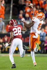 Clemson wide receiver Justyn Ross (8)  catches a bobbled pass over Alabama defensive back Josh Jobe (28) In second half action of the College Football Playoff National Championship game at Levi's Stadium in Santa Clara, Ca., on Monday January 7, 2019.