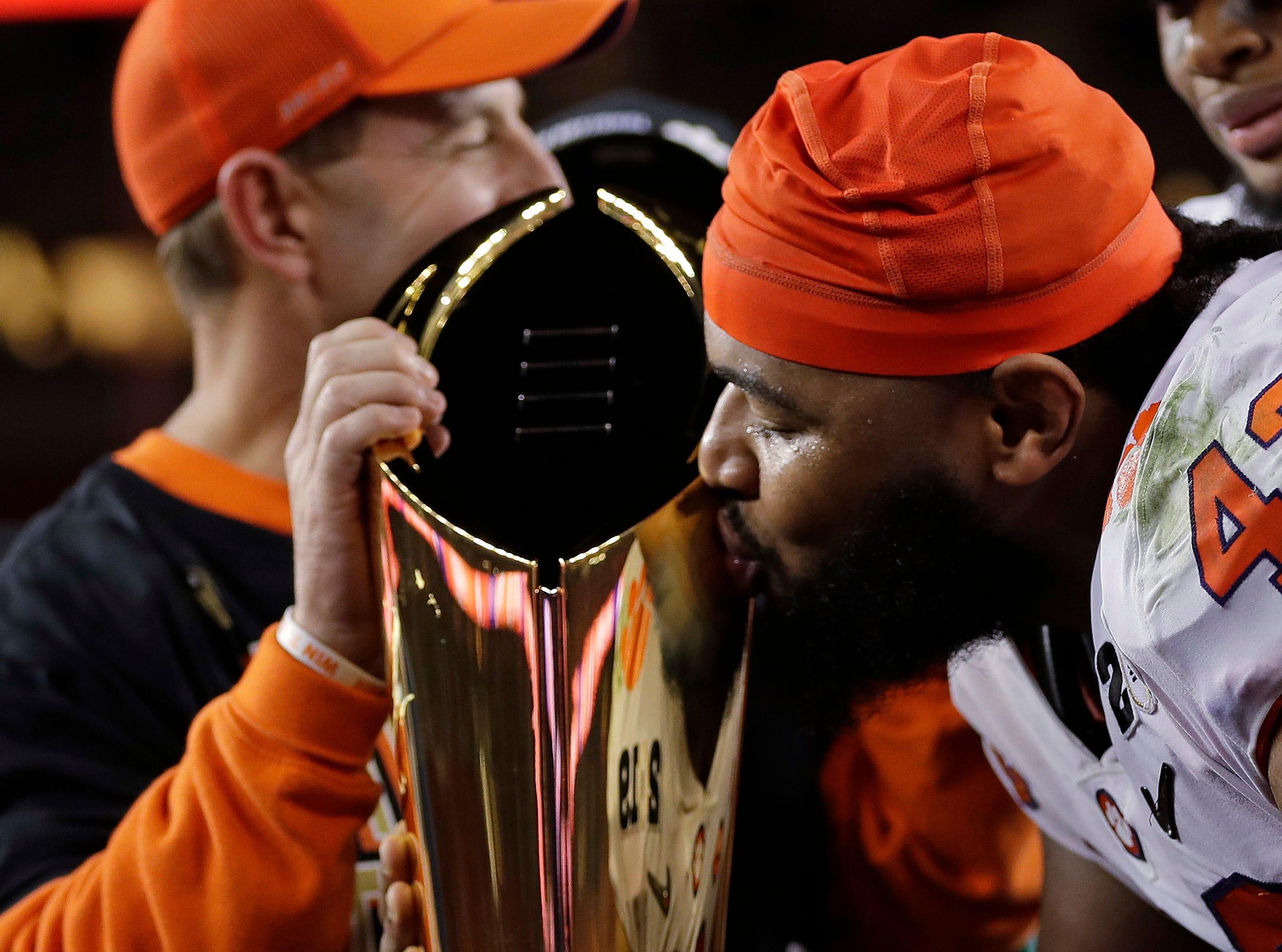 Clemson's Christian Wilkins kisses the trophy after the NCAA college football playoff championship game against Alabama, Monday, Jan. 7, 2019, in Santa Clara, Calif. Clemson beat Alabama 44-16. (AP Photo/David J. Phillip)