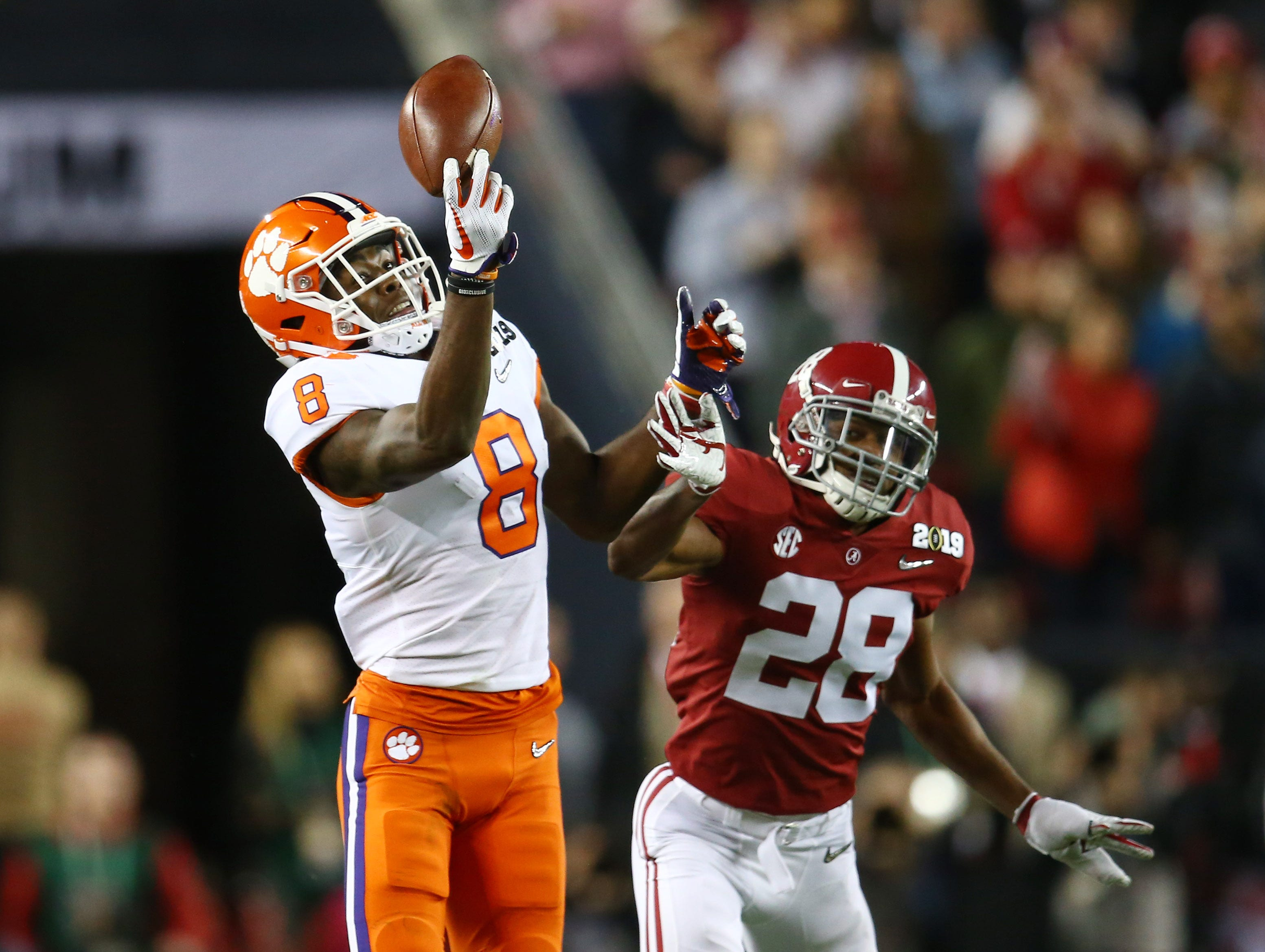 Jan 7, 2019; Santa Clara, CA, USA; Clemson Tigers wide receiver Justyn Ross (8) catches a pass against Alabama Crimson Tide defensive back Josh Jobe (28) in the third quarter during the 2019 College Football Playoff Championship game at Levi's Stadium. Mandatory Credit: Mark Rebilas-USA TODAY Sports
