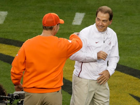 Alabama head coach Nick Saban talks to Clemson head coach Dabo Swinney before the NCAA college football playoff championship game Monday, Jan. 7, 2019, in Santa Clara, Calif. (AP Photo/Jeff Chiu)