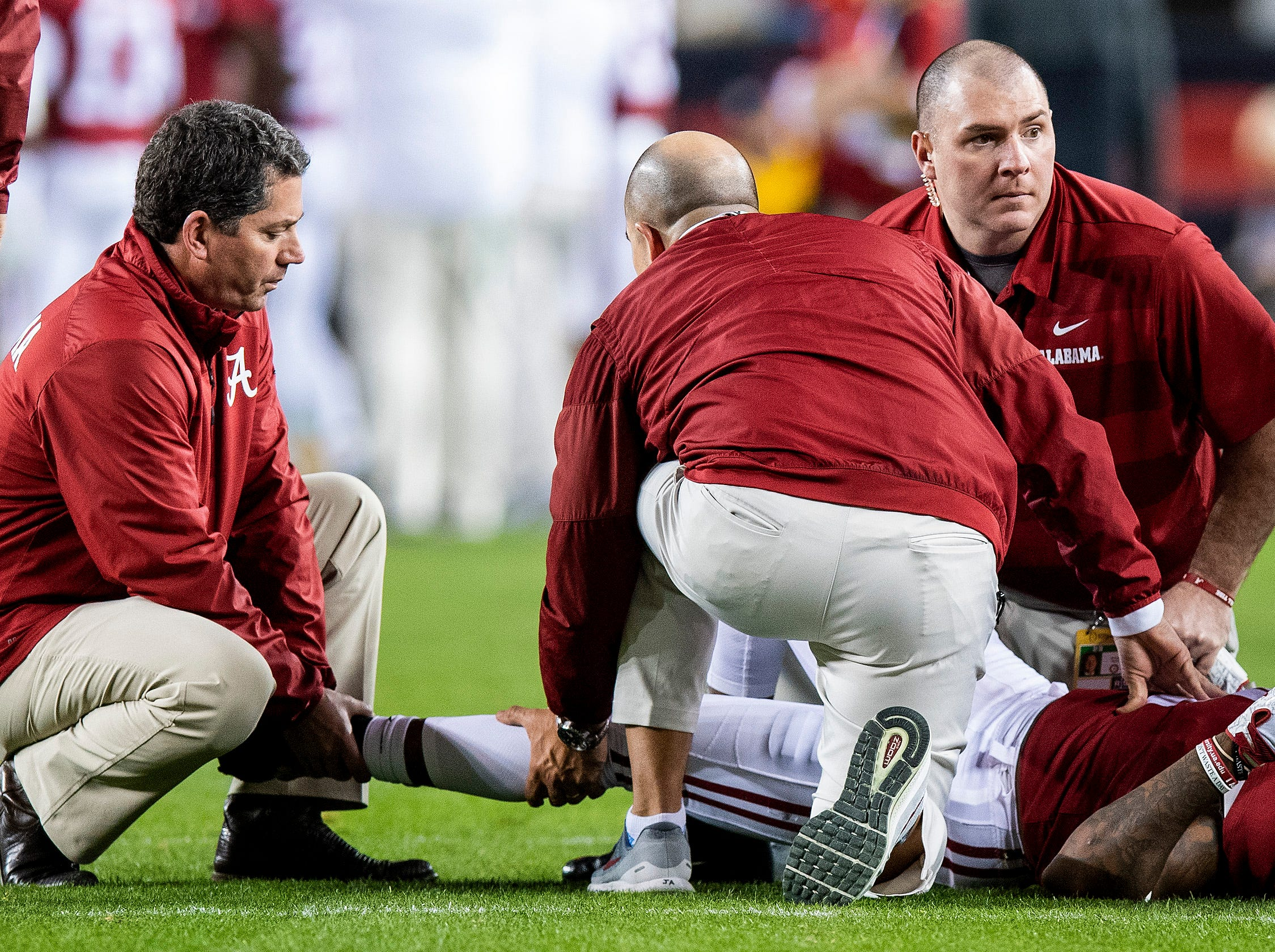 Alabama defensive back Saivion Smith (4) is injured In second half action against Clemson in the College Football Playoff National Championship game at Levi's Stadium in Santa Clara, Ca., on Monday January 7, 2019.