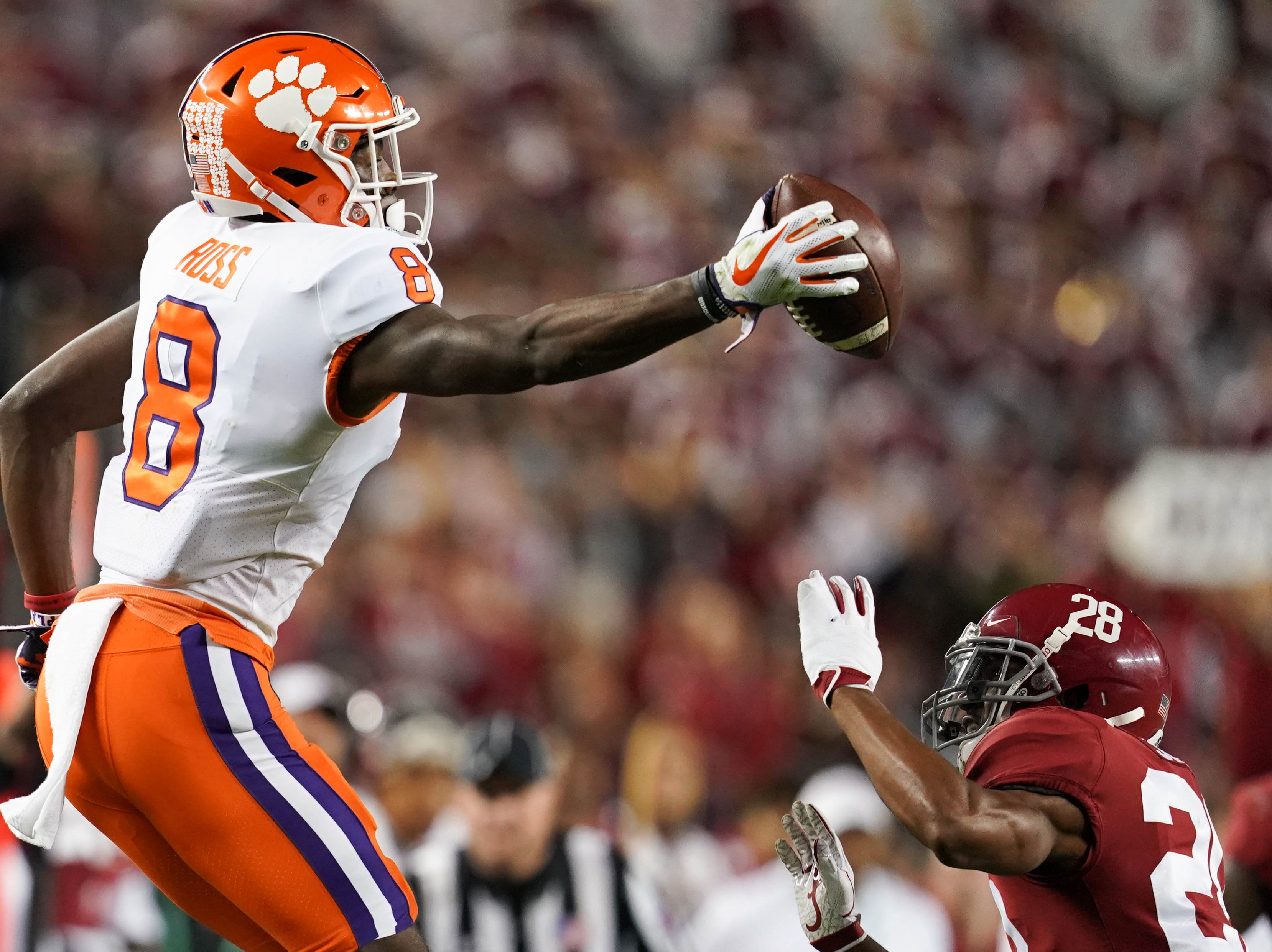 Jan 7, 2019; Santa Clara, CA, USA; Clemson Tigers wide receiver Justyn Ross (8) makes a catch ahead of Alabama Crimson Tide defensive back Josh Jobe (28) during the third quarter in the 2019 College Football Playoff Championship game at Levi's Stadium. Mandatory Credit: Kyle Terada-USA TODAY Sports