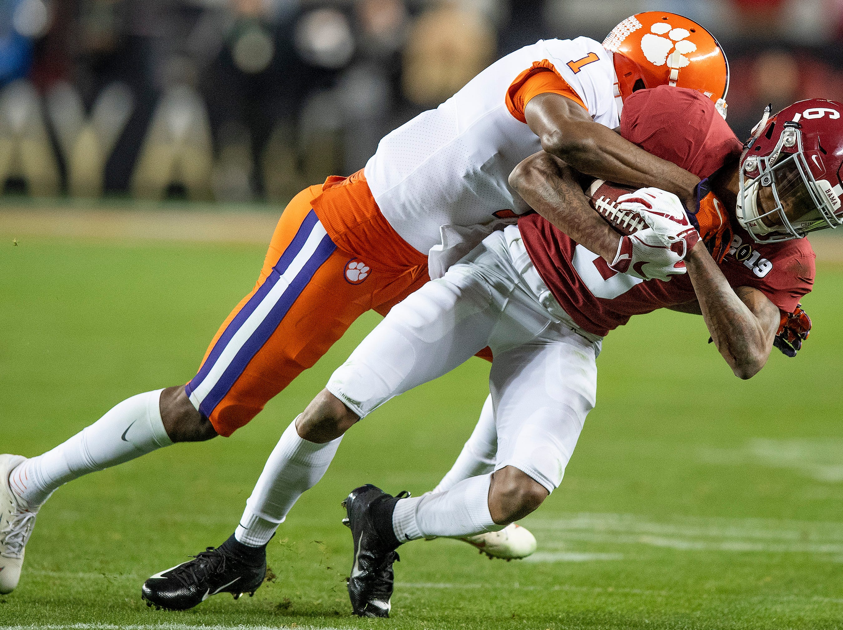Alabama wide receiver DeVonta Smith (6) is stopped by Clemson cornerback Trayvon Mullen (1) In second half action of the College Football Playoff National Championship game at Levi's Stadium in Santa Clara, Ca., on Monday January 7, 2019.