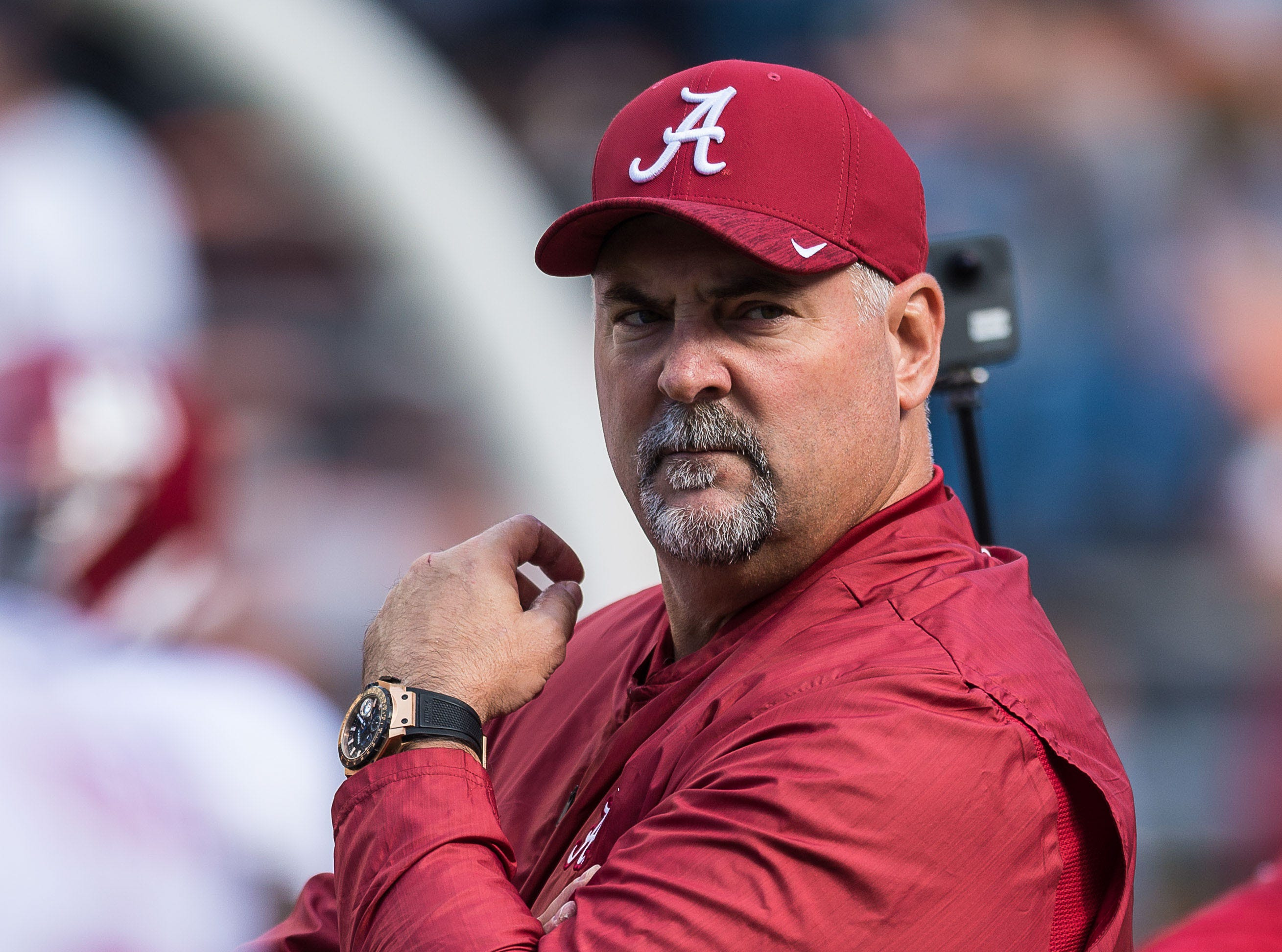 Oct 20, 2018; Knoxville, TN, USA; Alabama Crimson Tide associate head coach and defensive line coach Craig Kuligowski watches warmups before a game against the Tennessee Volunteers at Neyland Stadium. Mandatory Credit: Bryan Lynn-USA TODAY Sports