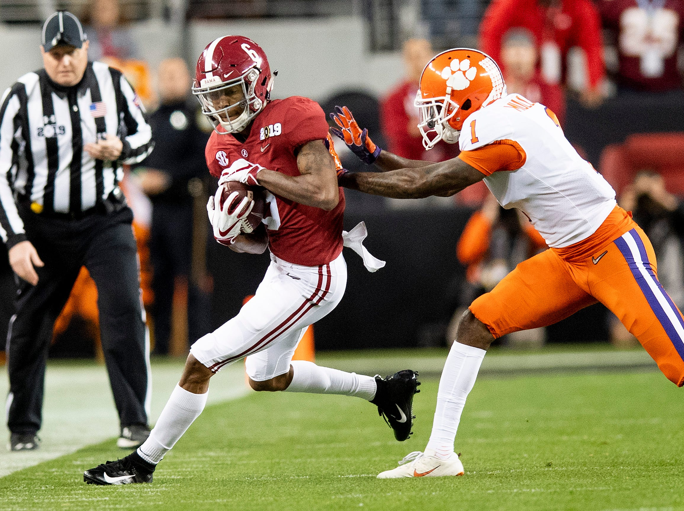 Alabama wide receiver DeVonta Smith (6) is forced out of bounds by Clemson cornerback Trayvon Mullen (1) In first half action of the College Football Playoff National Championship game at Levi's Stadium in Santa Clara, Ca., on Monday January 7, 2019.