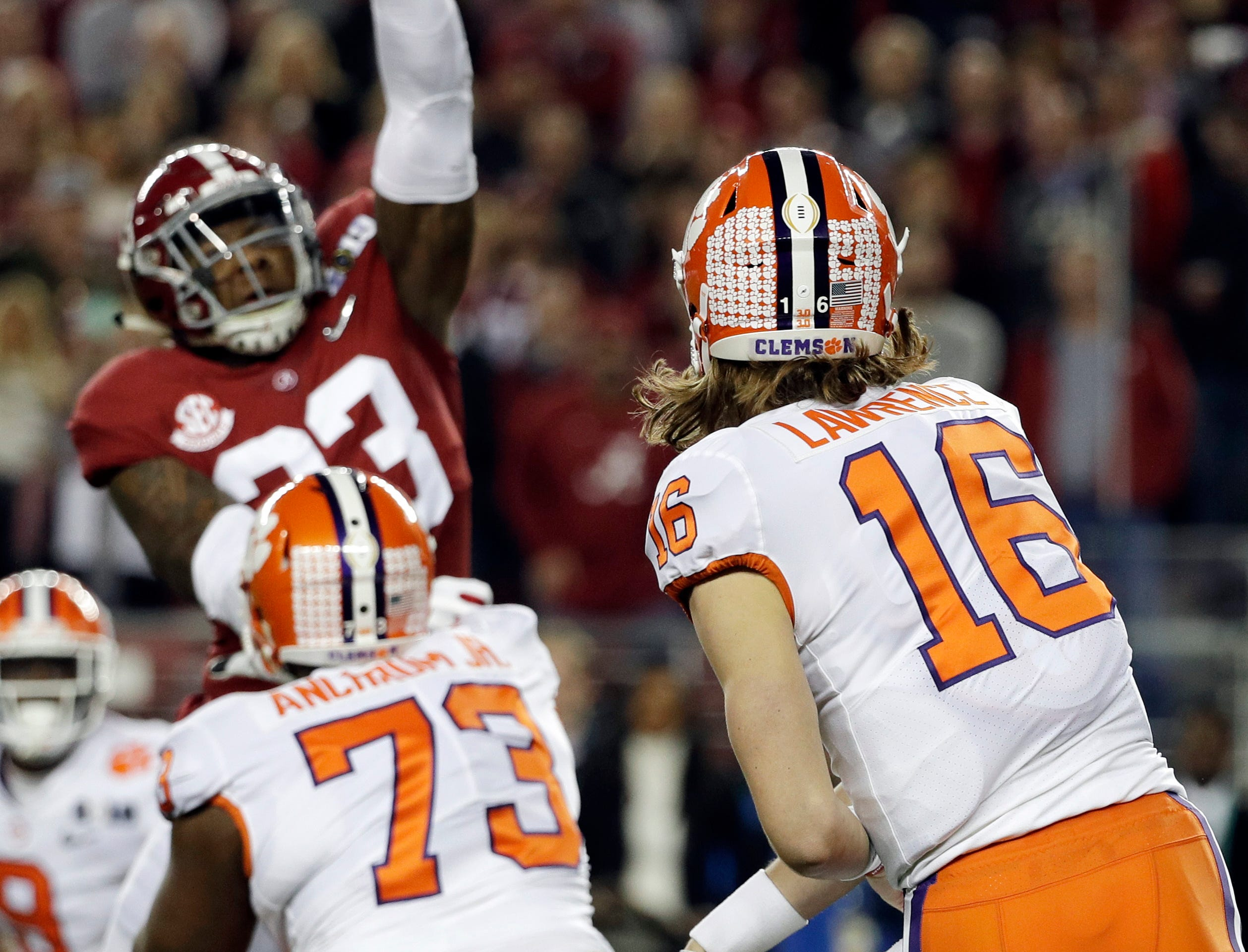 Alabama's Anfernee Jennings knocks down a pass by Clemson's Trevor Lawrence during the first half the NCAA college football playoff championship game, Monday, Jan. 7, 2019, in Santa Clara, Calif. (AP Photo/David J. Phillip)