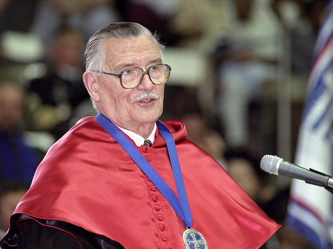 Nobel economics laureate and MTSU alumnus Dr. James Buchanan speaks to MTSU graduates at the May 2000 commencement ceremony. Buchanan, a Rutherford County native, died in 2013 at age 93.