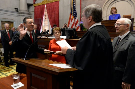 House Speaker Glen Casada, R-Franklin, left, is sworn in by Tennessee Supreme Court Chief Justice Jeff Bivins, second from right, on the opening day of the 111th General Assembly Tuesday, Jan. 8, 2019, in Nashville, Tenn. Holding the Bible for Casada is his mother, Karen, and standing to far right is his  his father, Dick Casada.