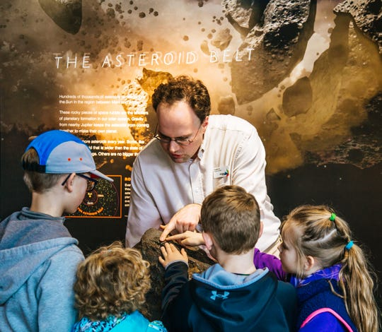 Russell Orr, educational specialist at Discovery Park of America, engages with eager learners in the Science, Space and Technology Gallery.