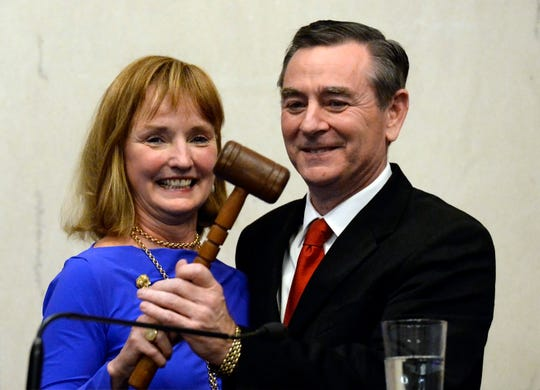 Outgoing House Speaker Beth Harwell, R-Nashville, left, hands the gavel over to newly elected House Speaker Glen Casada, R-Franklin, on the opening day of the 111th General Assembly Tuesday, Jan. 8, 2019, in Nashville, Tenn.