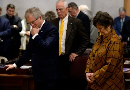 Legislative members and their families pray during the House of Representatives opening day of the 111th General Assembly on Tuesday, Jan. 8, 2019, in Nashville, Tenn.