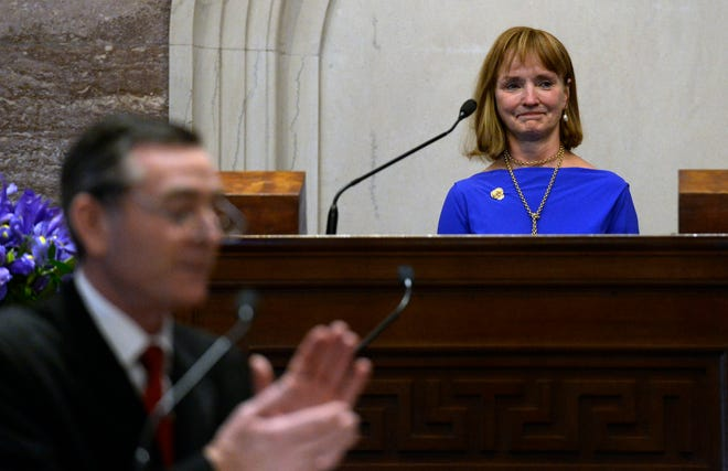 Former House Speaker Beth Harwell cries as she receives a standing ovation from her colleagues and newly elected House Speaker Glen Casada during the opening day of the 111th General Assembly on Tuesday, Jan. 8, 2019, in Nashville. Harwell made history eight years ago as the state's first female speaker of the House.